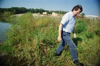 Roger Rayle inspects tributary, 1997
