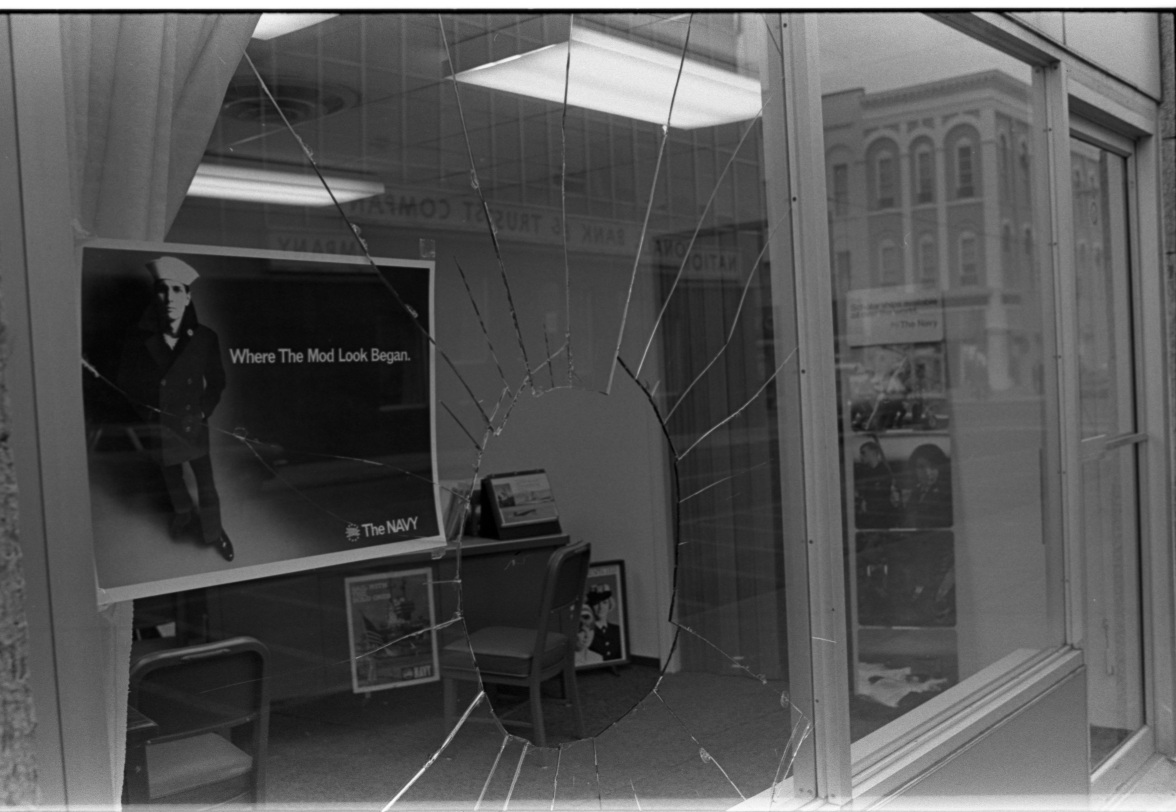 Old barber shop window - Vandalized Window At U S Navy Recruiting Office On E Washington December 1970