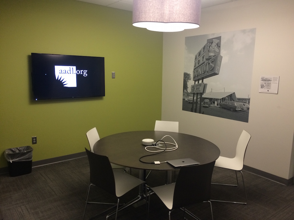 Meeting Room A at Westgate Branch, showing a 5-seat table and wall-mounted flatscreen.