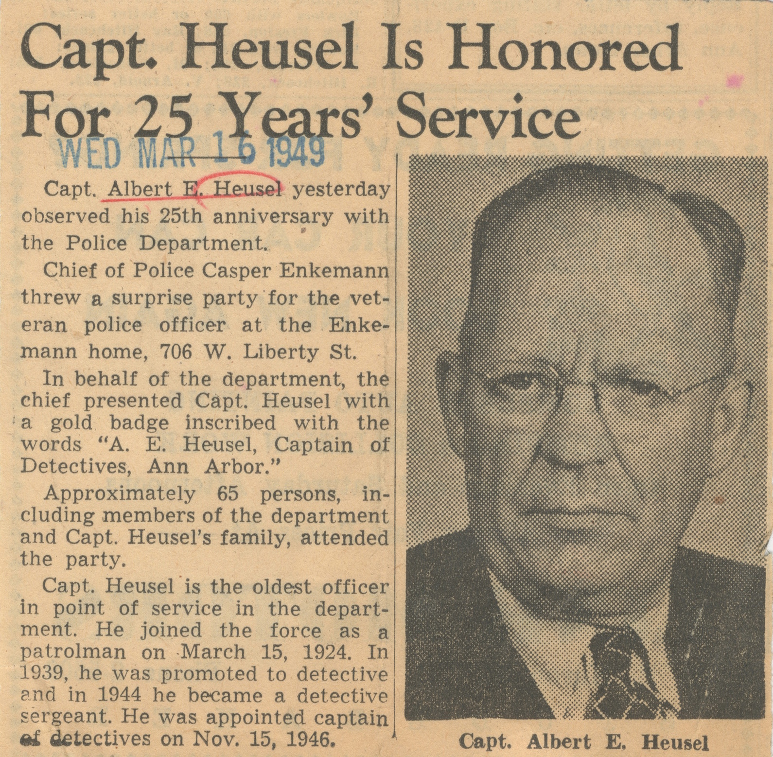Capt. Heusel Is Honored For 25 Years' Service image