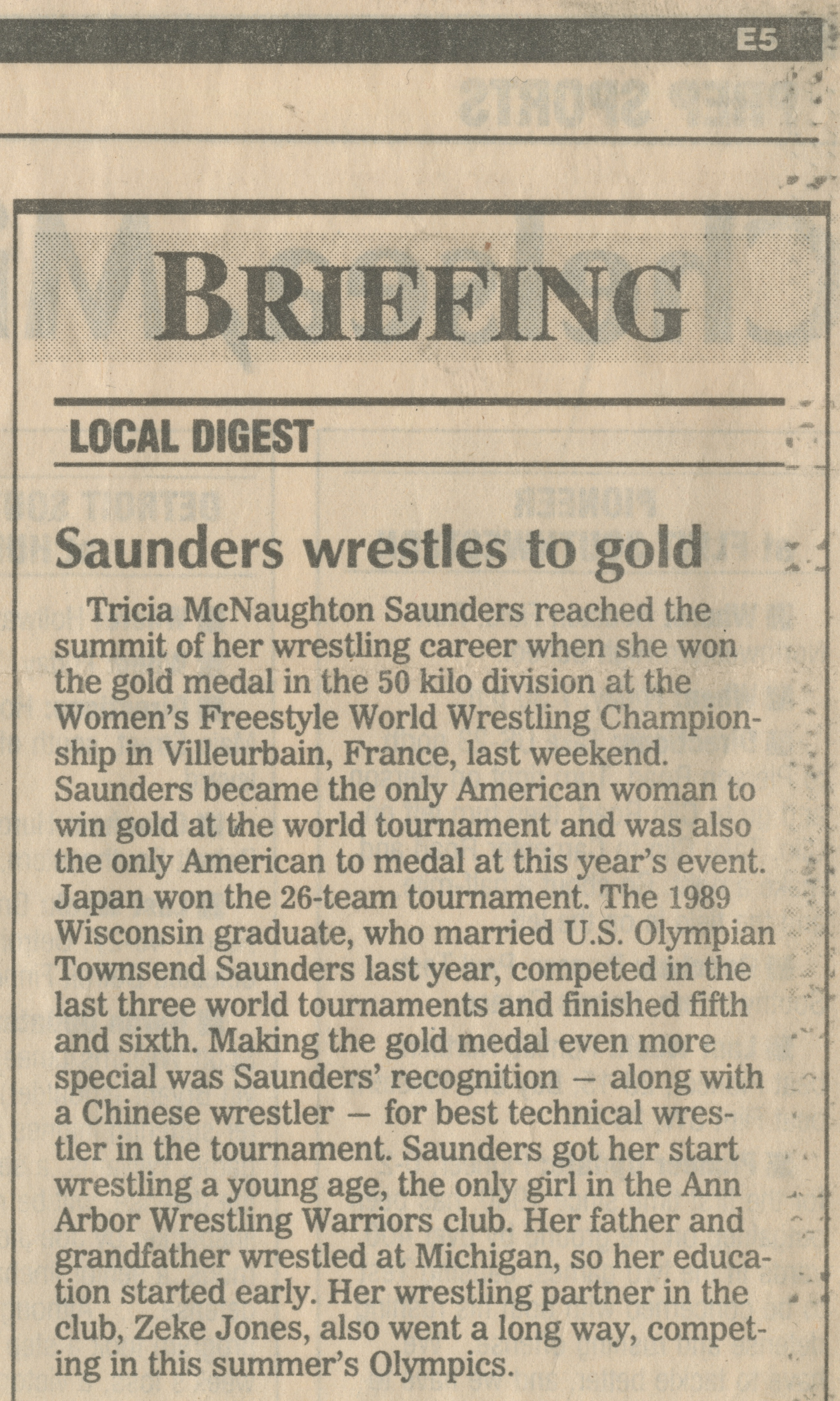 Saunders wrestles to gold image