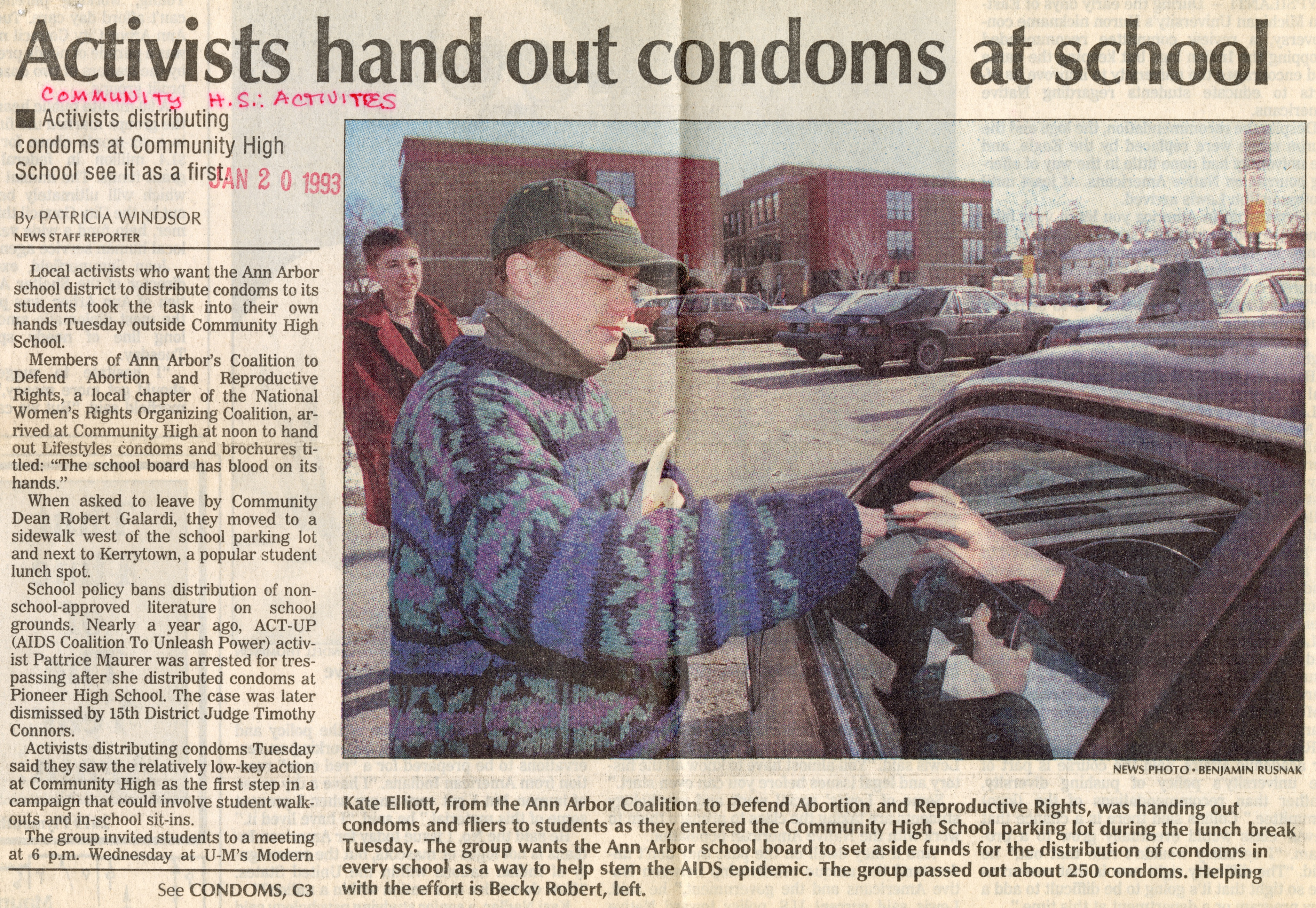 Activists hand out condoms at school image