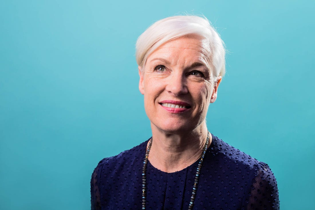 Cecile Richards in front of a turquoise background