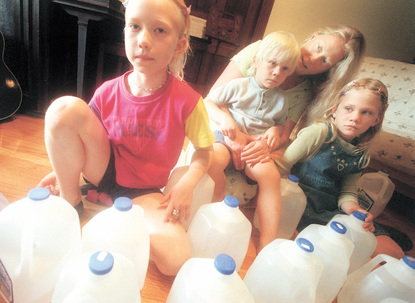 Corine Hillebrand and her children, photograph by Ann Arbor News photographer Leisa Thompson, June 2000