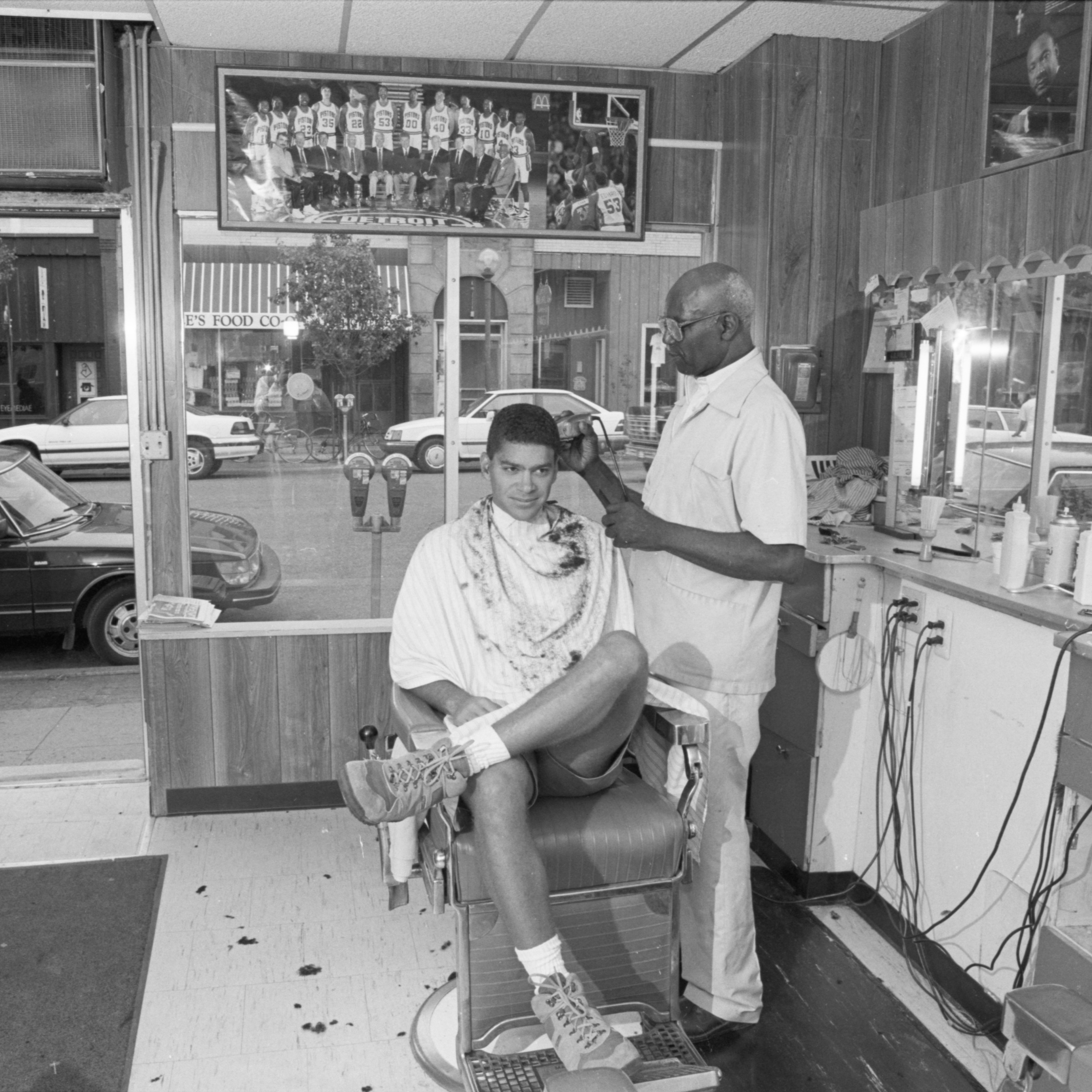 Barber J.D. Hall cuts a client's hair