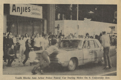 Youth Blocks Police Car on S. University Ave