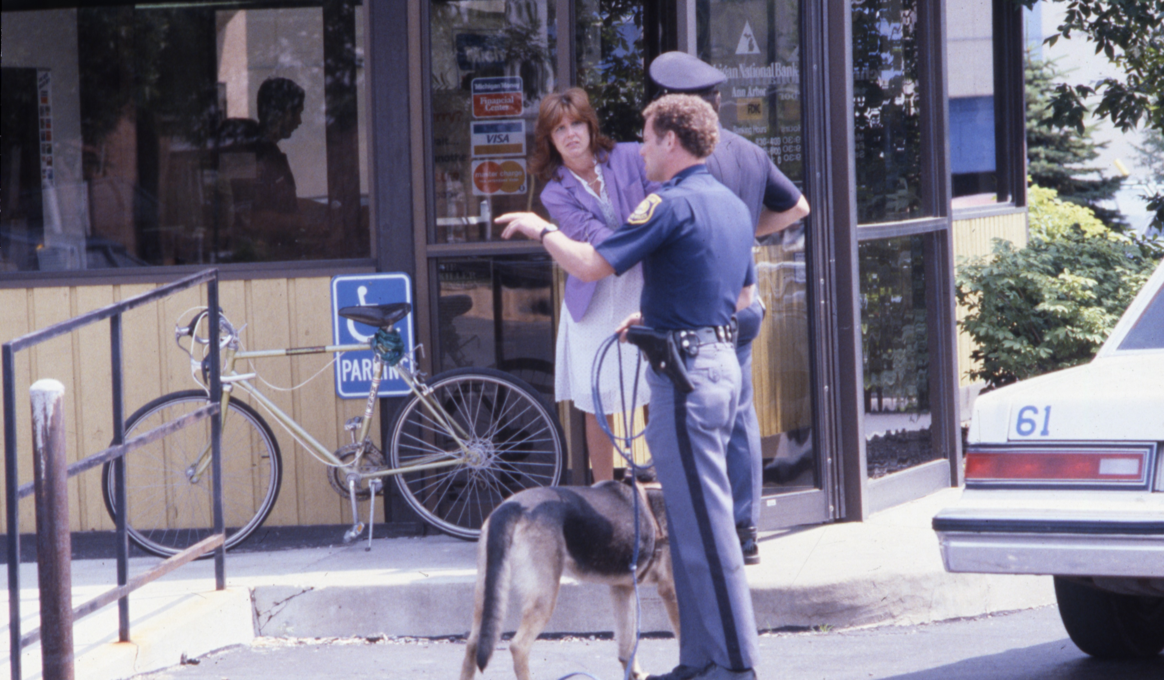 Ann Arbor Police Question Employees at Michigan National Bank on W Stadium Blvd, Scene of Robbery, June 1984 image