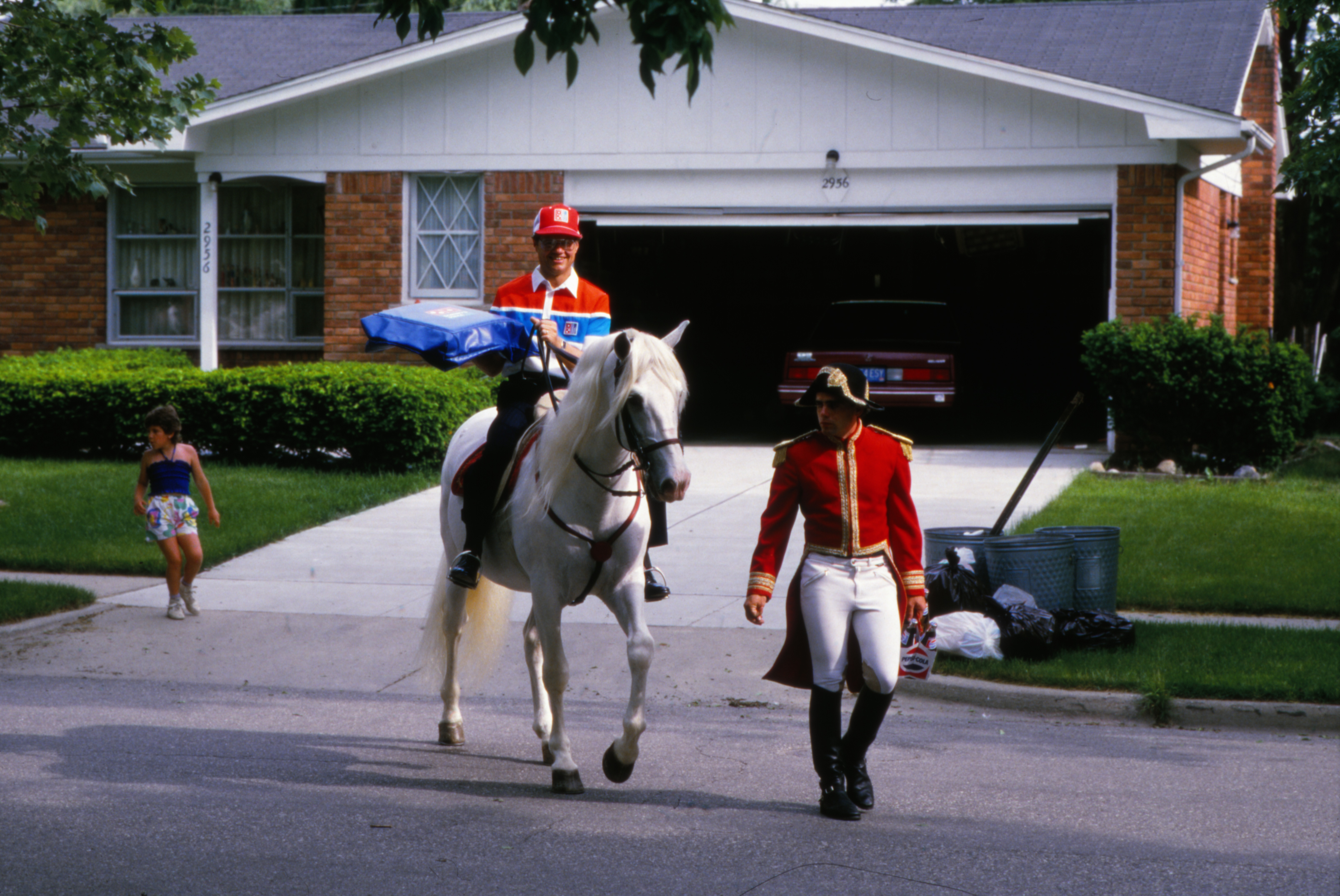 Tom Monaghan Delivers Pizza on Horseback image