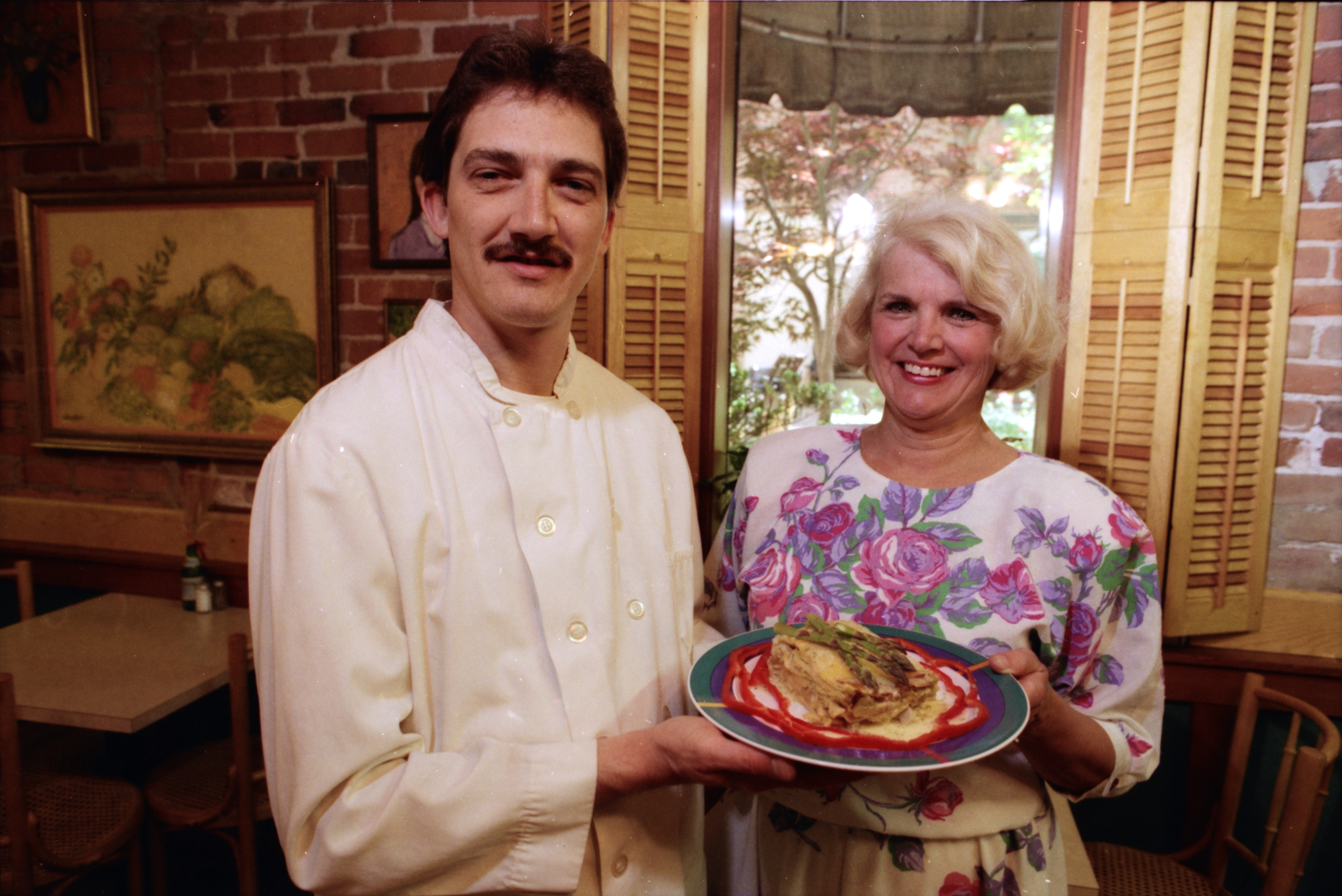 Chef Ian Cummings and Owner Marguerite Oliver with Asparagus Prosciutto Lasagna image