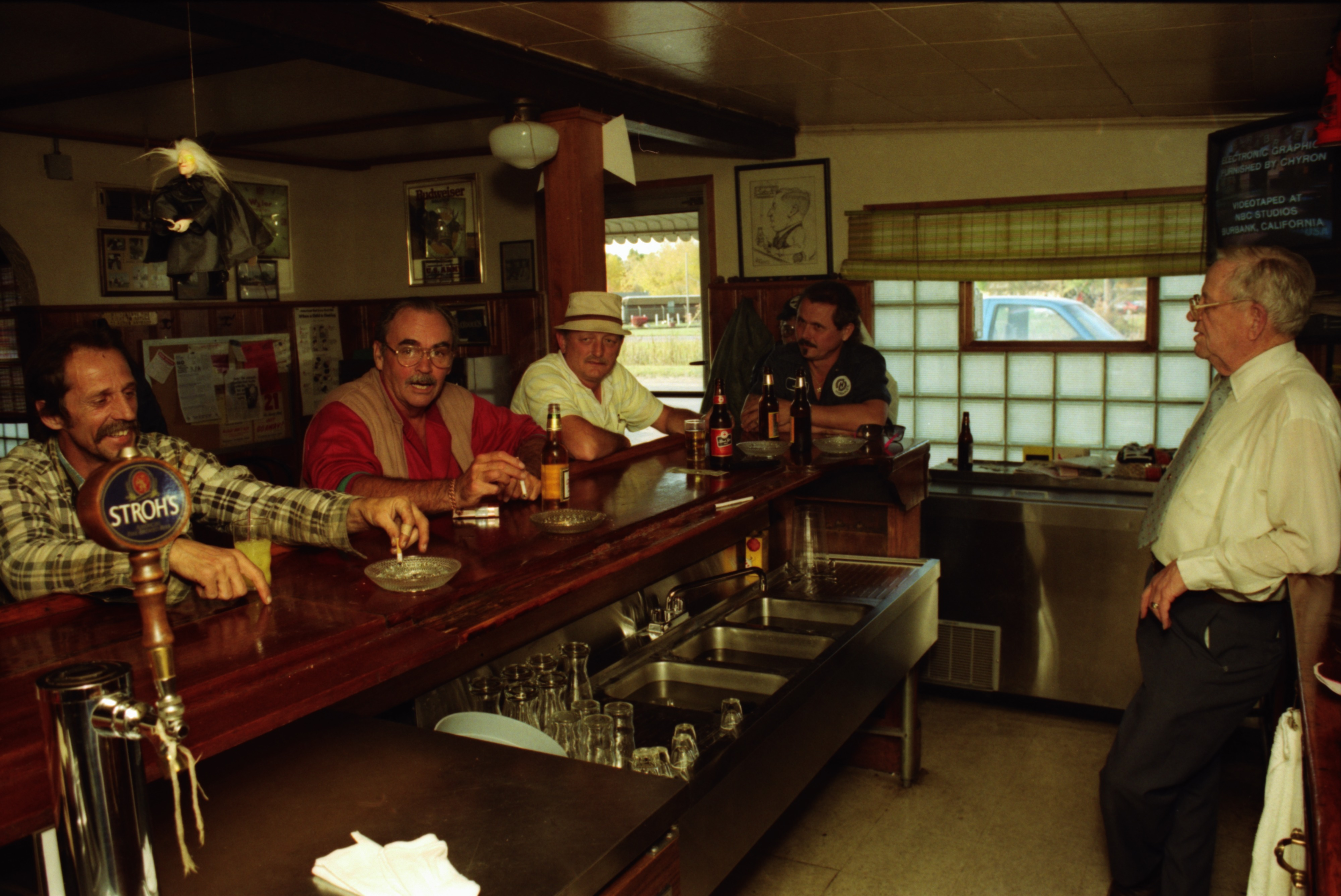 Regulars Discuss Future of GM's Willow Run Plant at the Orange Lantern Bar, October 1992 image