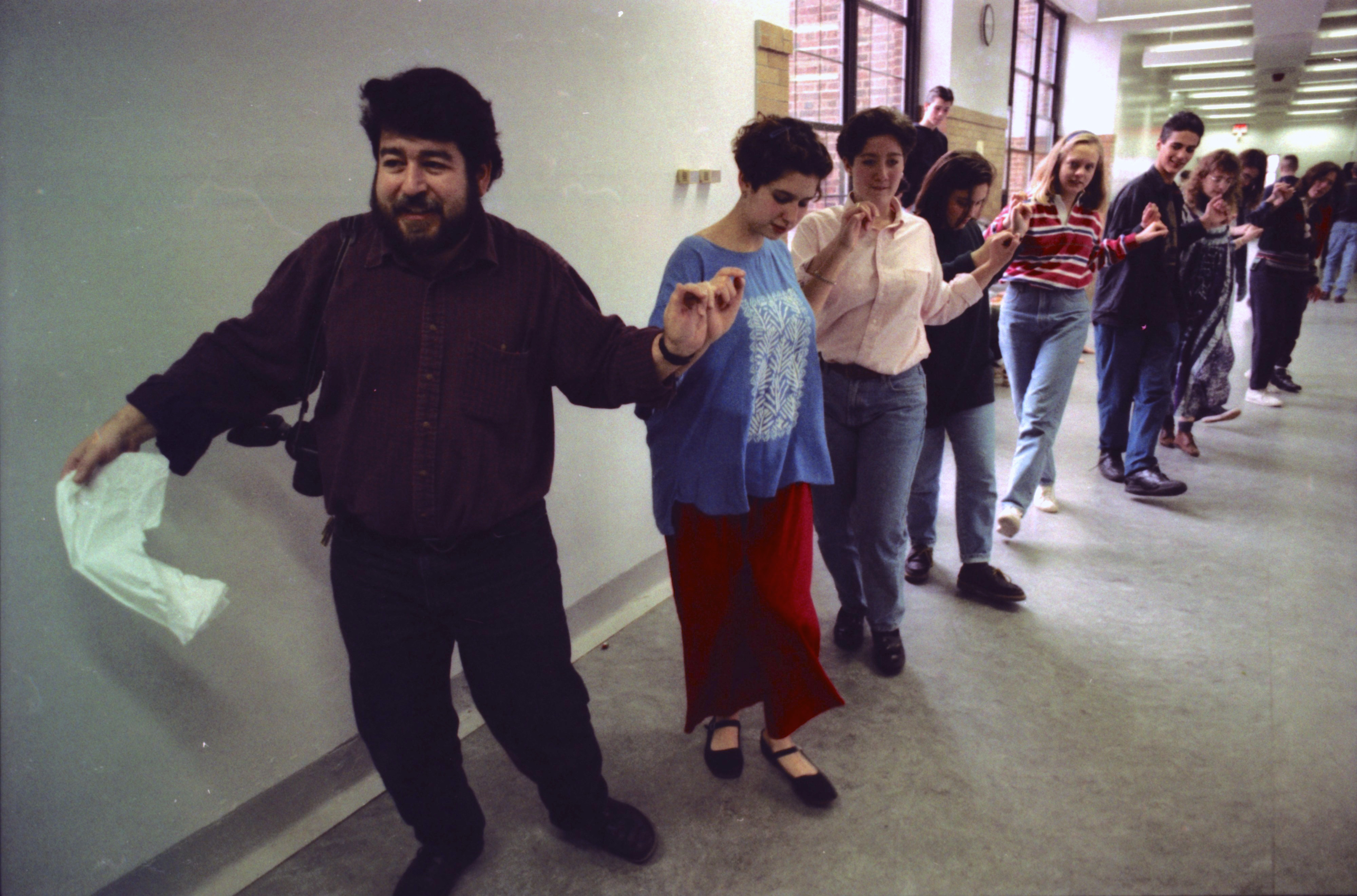 Teacher Mike Mouradian Leads Dance at Community High School's Multi-Ethnic Festival, November 1992 image