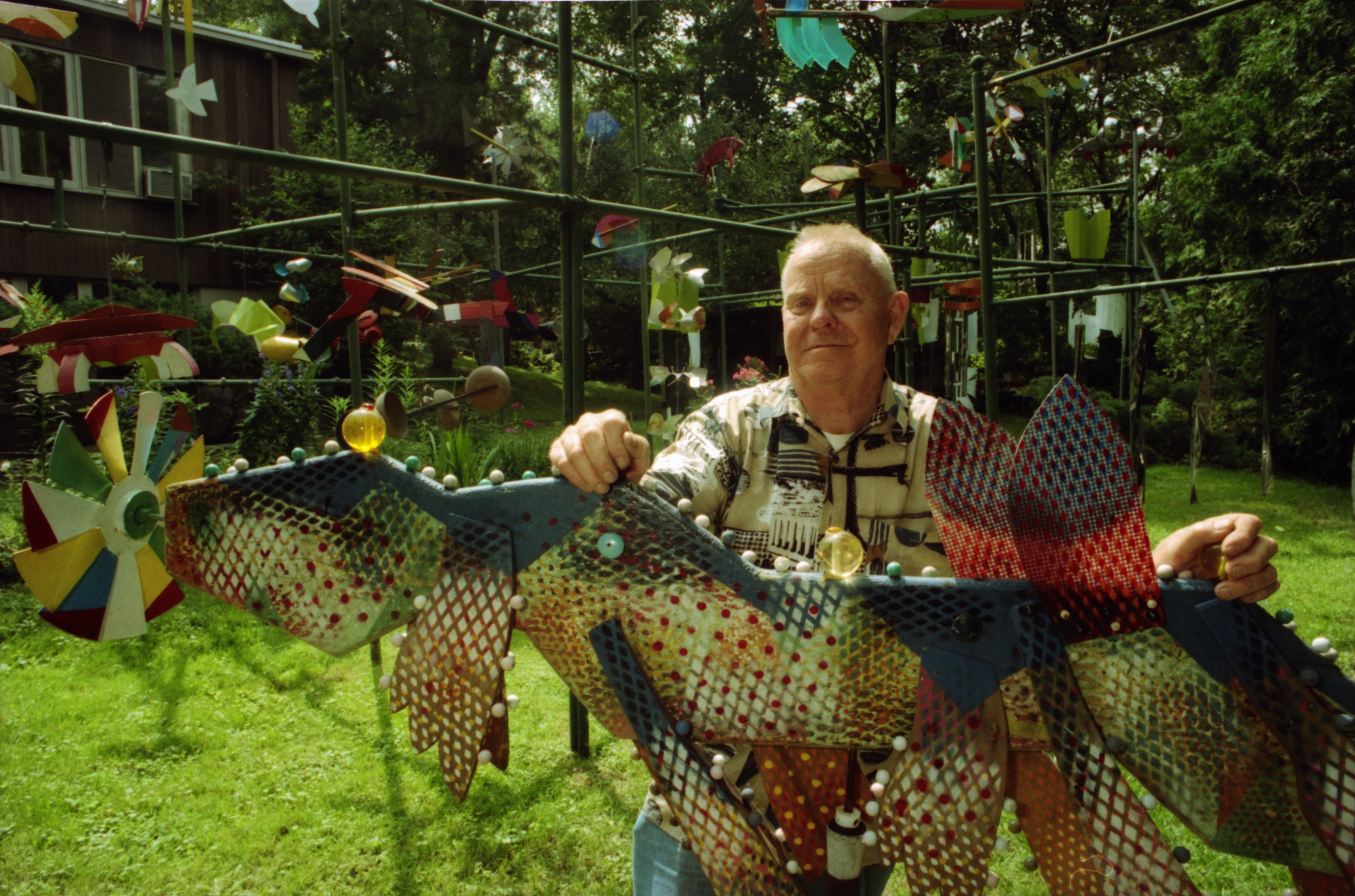 "Image from Artist Gerome Kamrowski with one of his 'beaded beasts"" at his home, August 1993"