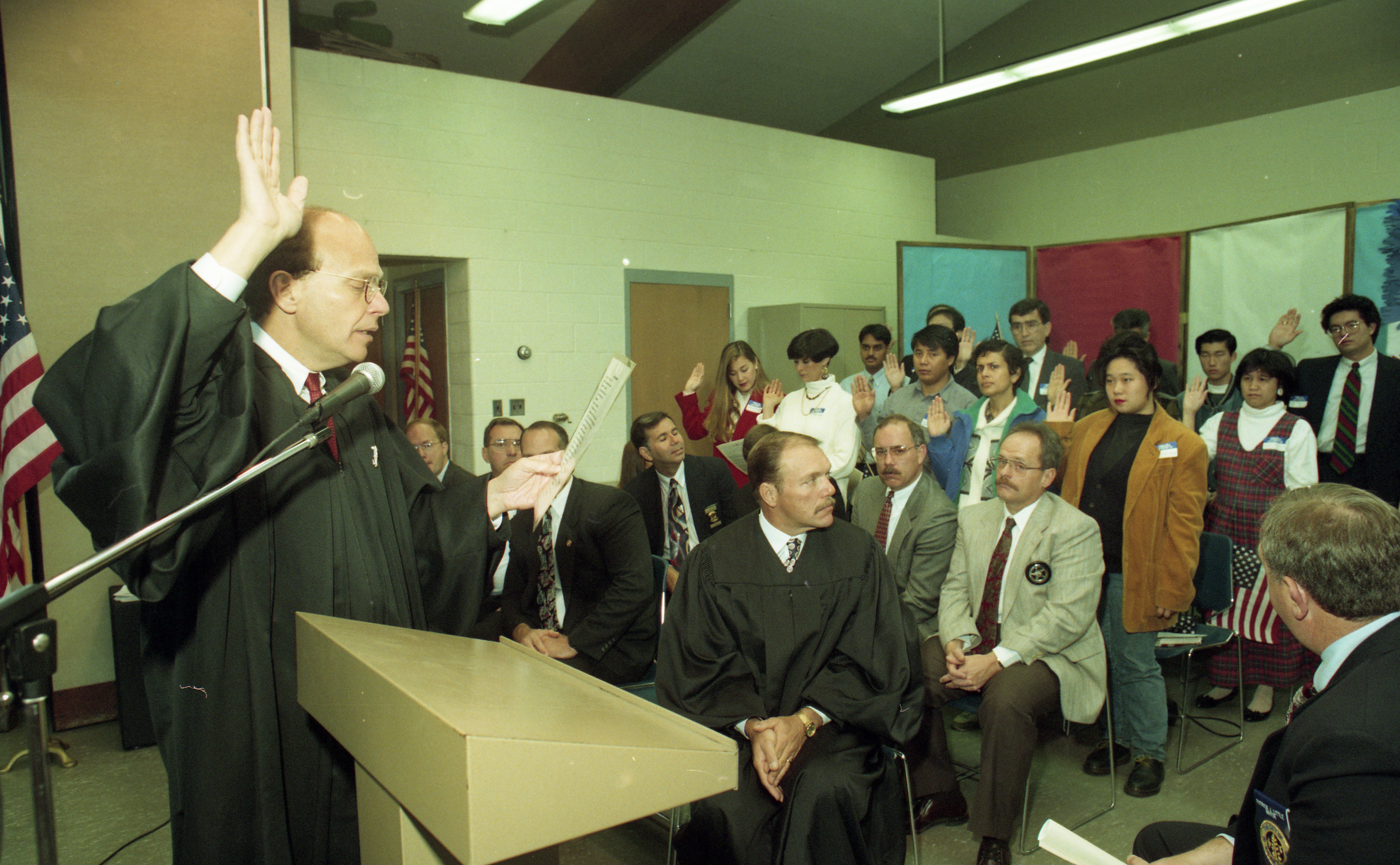U.S. District Court Judge Friedman Administers Oath at U.S. Citizenship Ceremony At Houghton Elementary School In Saline, October 1993 image