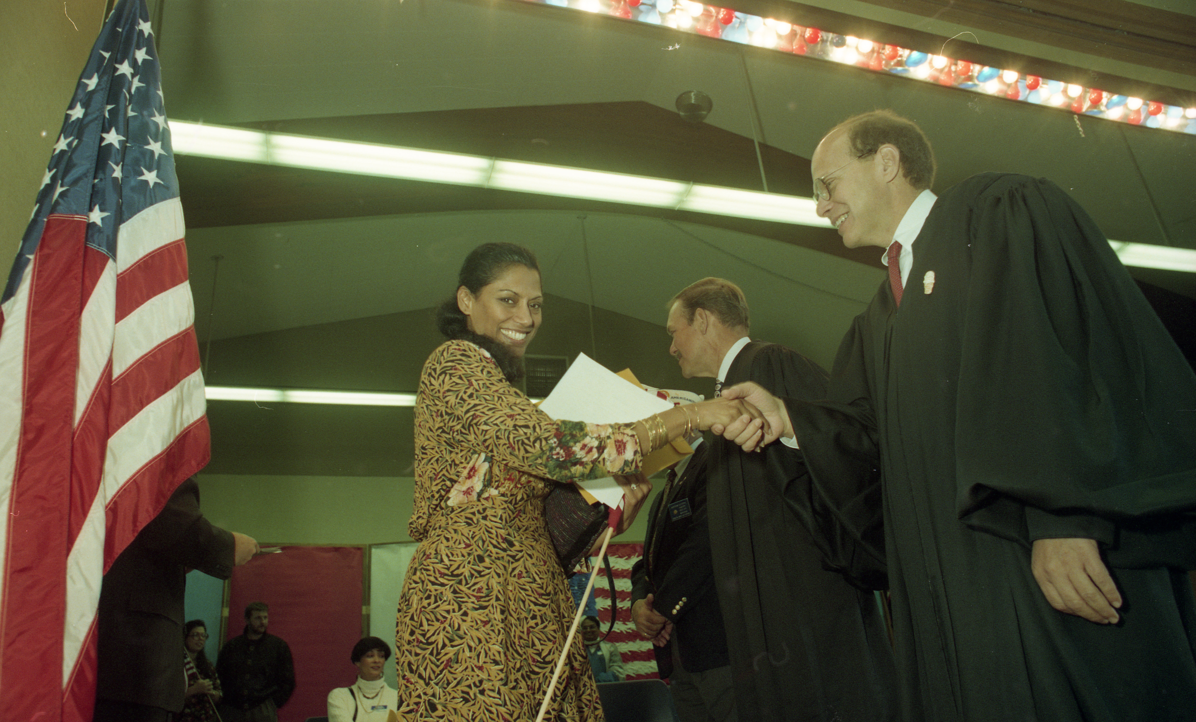 Judge Friedman Congratulates New U.S. Citizen In Ceremony At Houghton Elementary School In Saline, October 1993 image