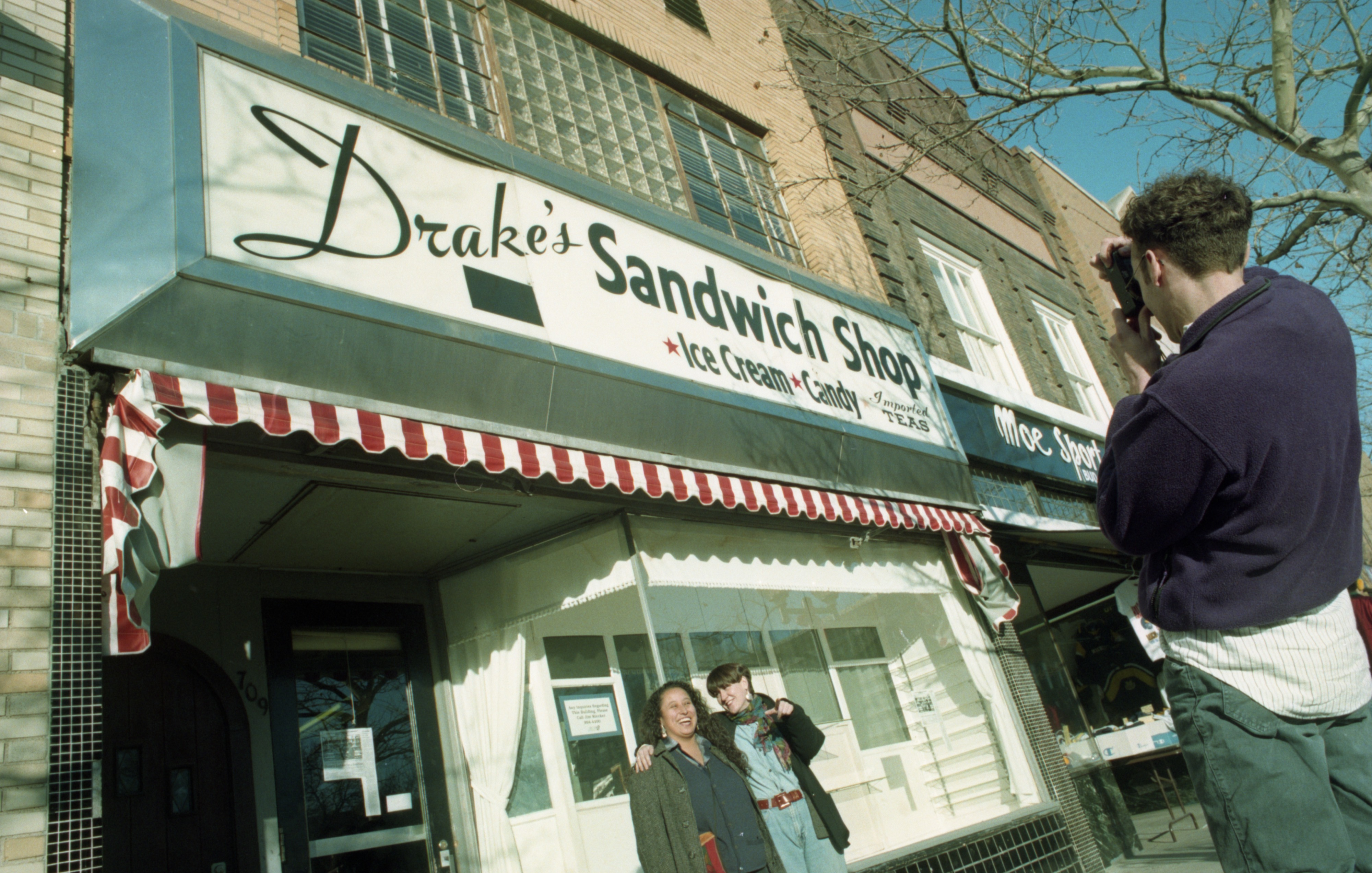 Elsa Barboza & Betsy Esch Pose For Picture In Front Of Drake's Sandwich Shop, December 29, 1993 image