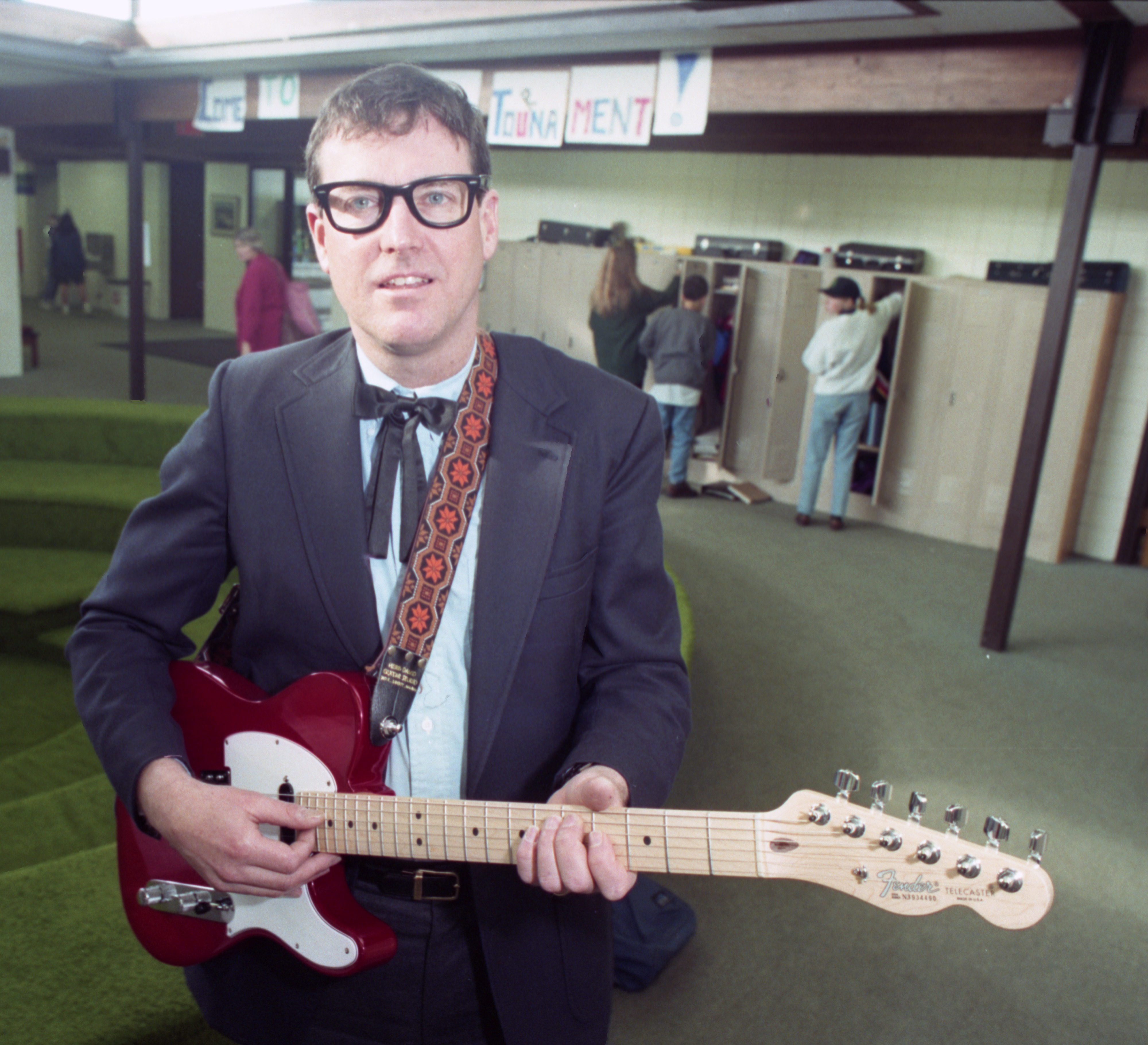 Headmaster, Tony Paulus, Impersonates Buddy Holly For Greenhills Annual Auction, February 26, 1994 image