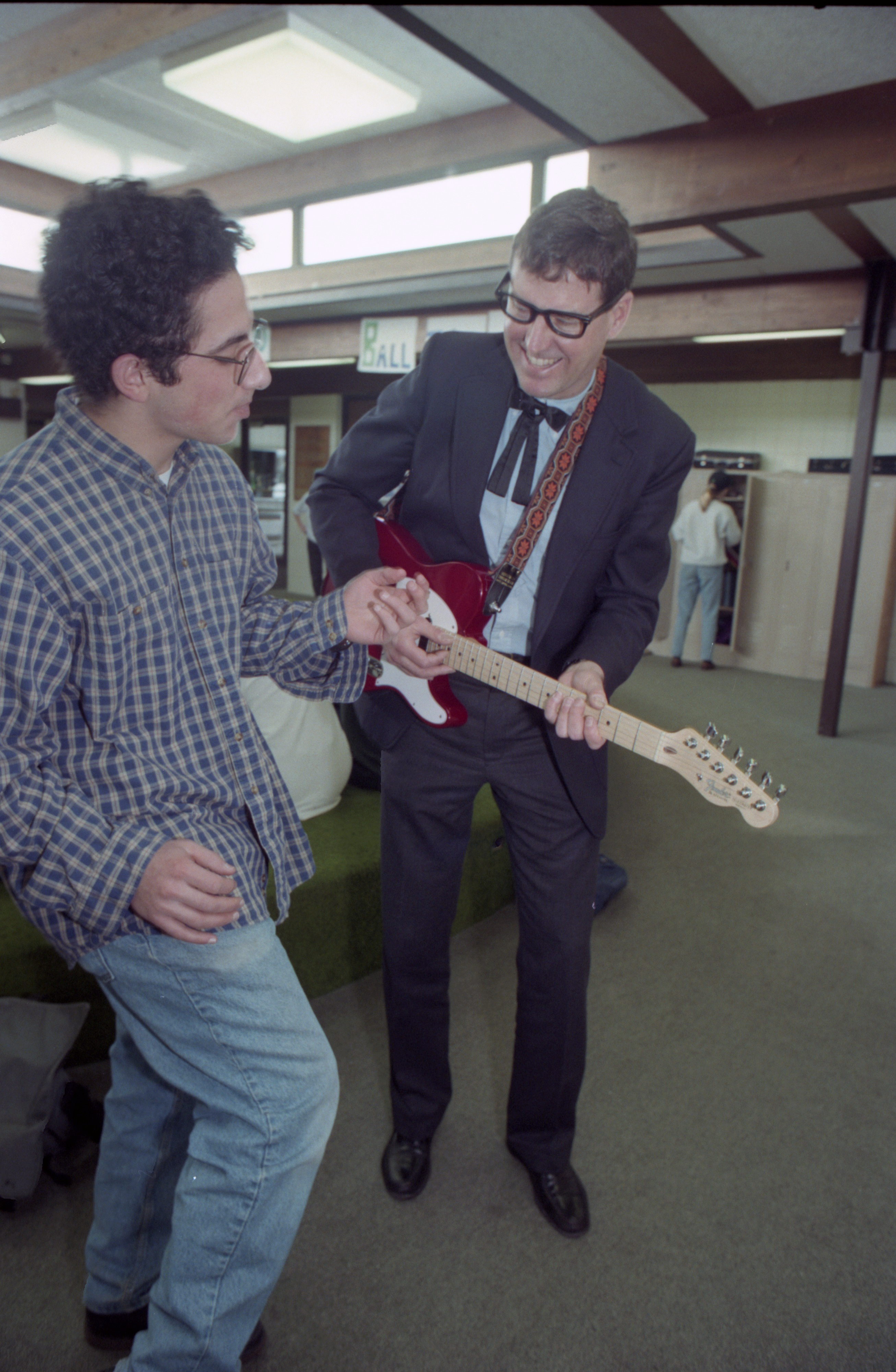 Headmaster, Tony Paulus As Buddy Holly For Greenhills Annual Auction With Student Aaron Nathan, February 26, 1994 image