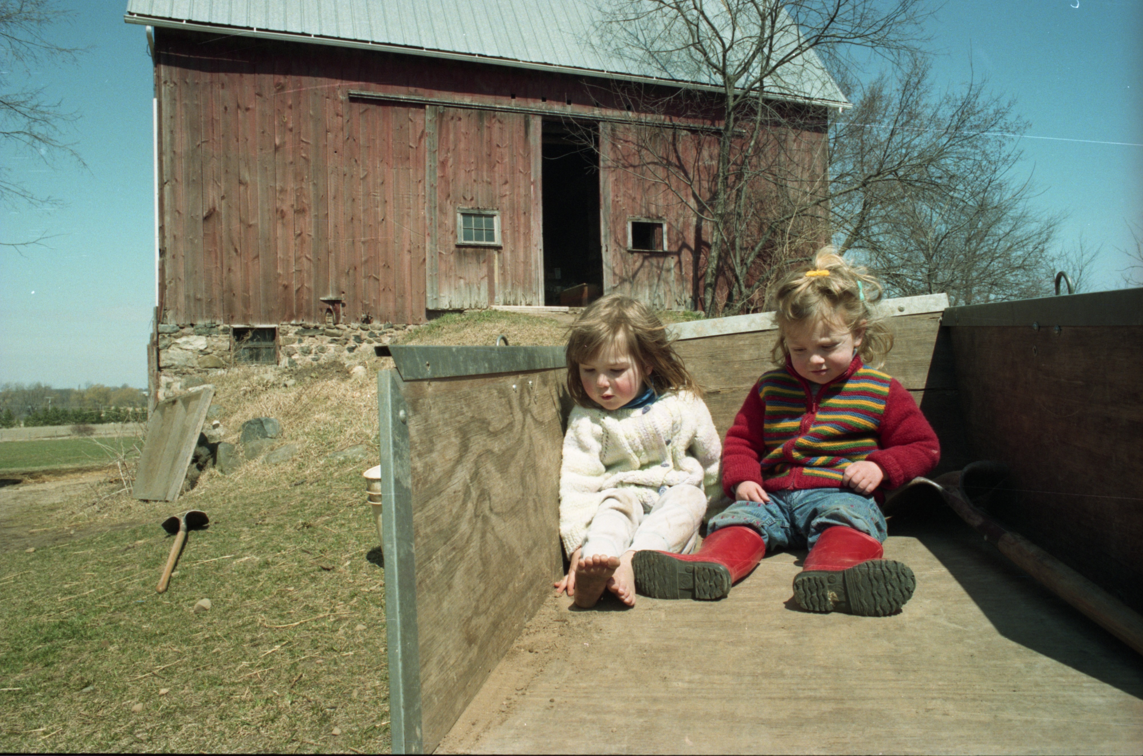 Laura Chalmers & Friend Relax In Wagon At Community Farm, April 1994 image