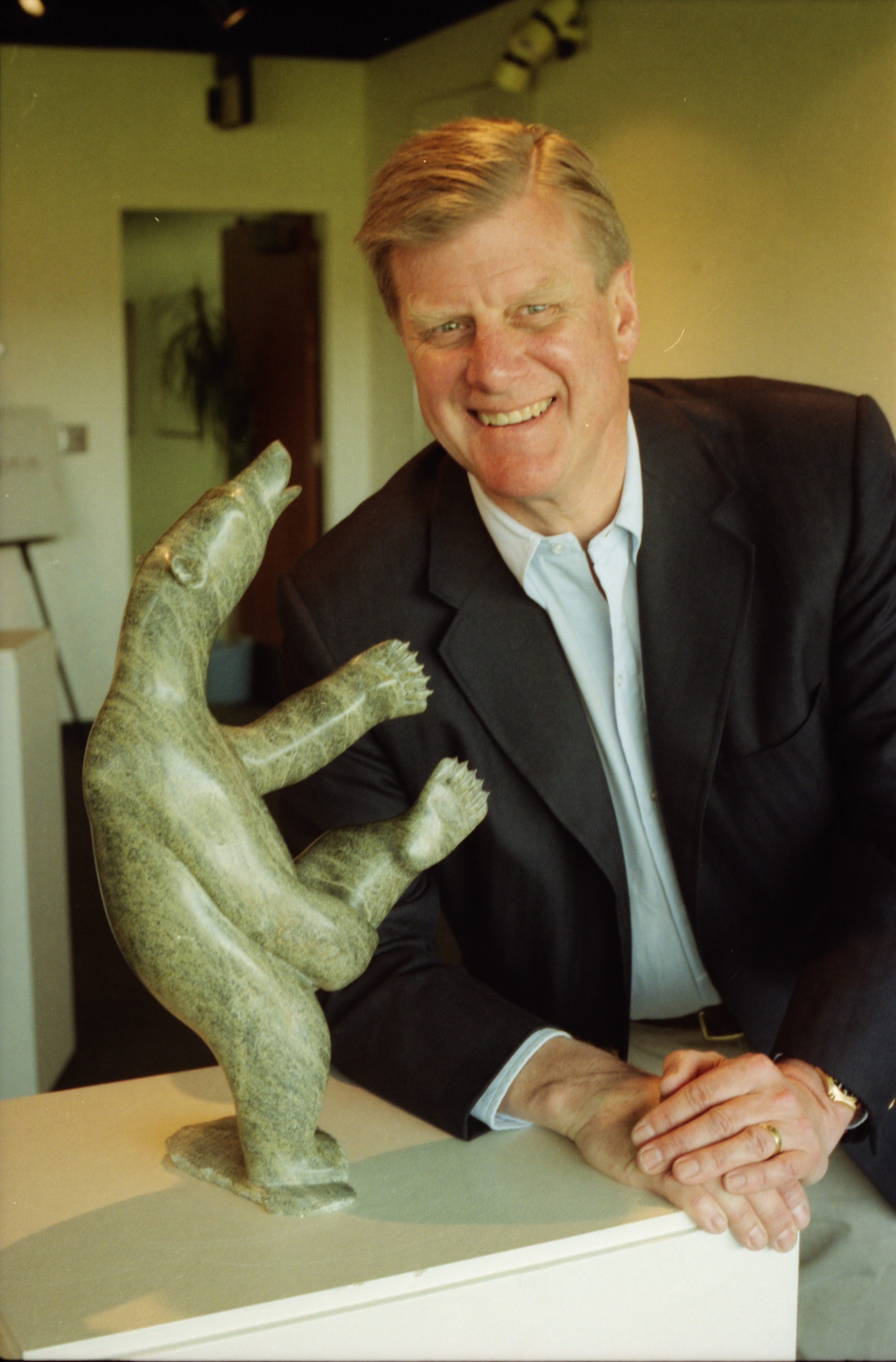 Portrait of Philip Power with Inuit Sculpture as Eskimo Arts Gallery Closes, April 1994 image