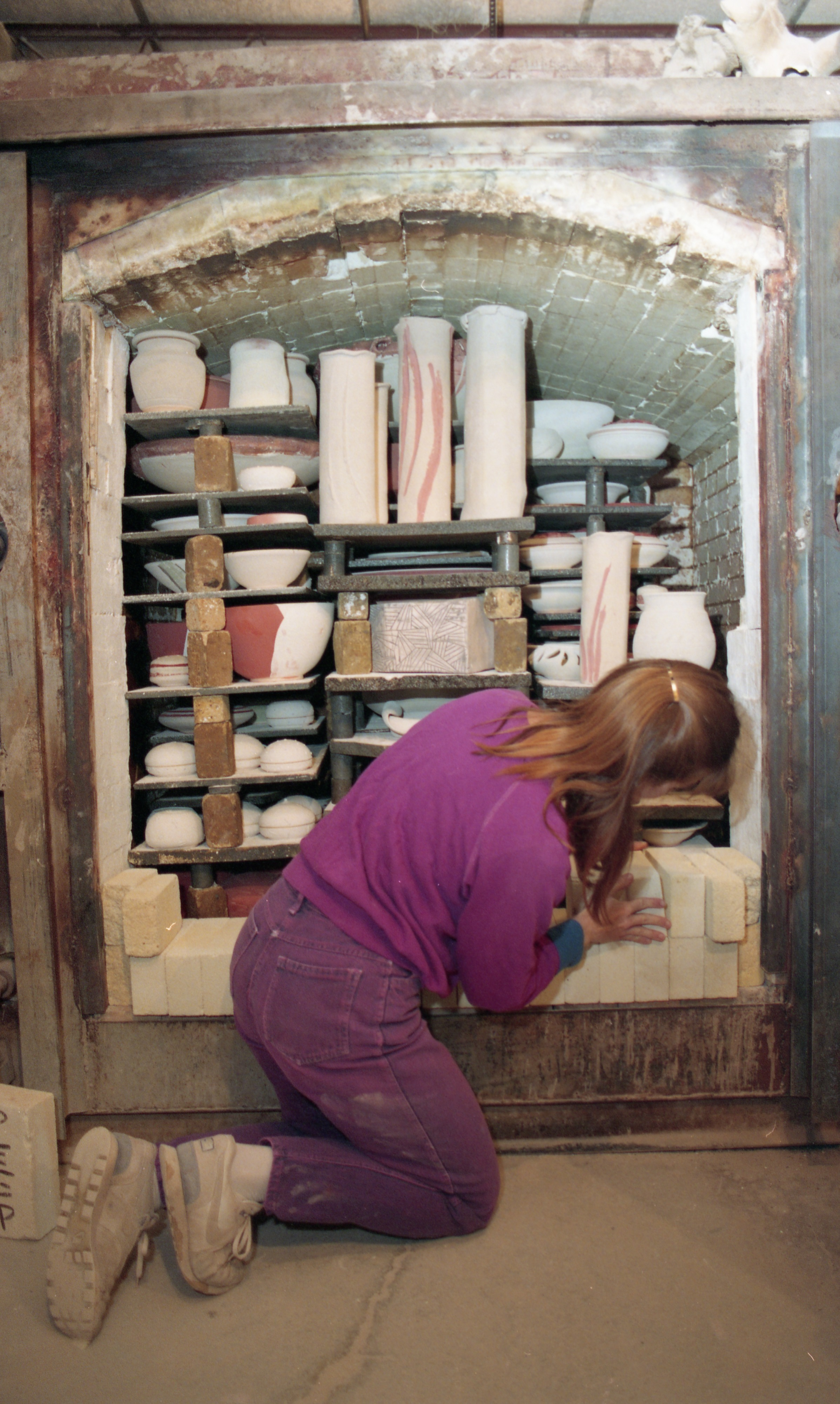 Jeri Hollister Prepares The Kiln For Firing At The Ann Arbor Potters Guild, November 1994 image