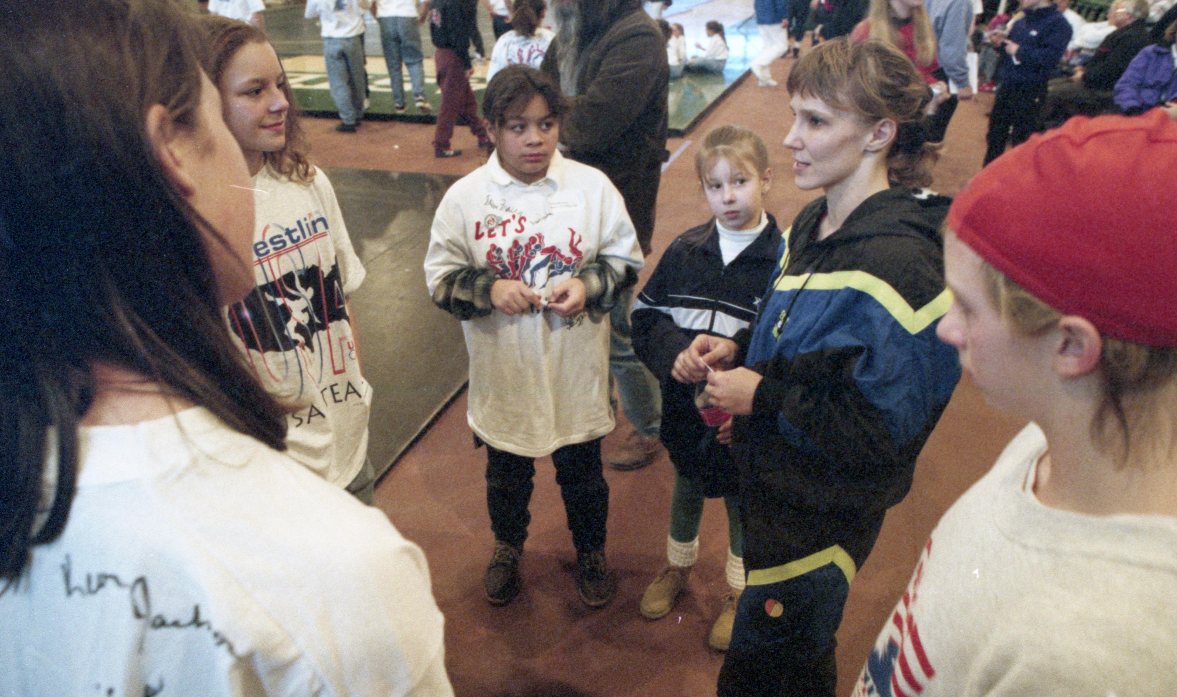 Tricia McNaughton Saunders Chats With Young Female Wrestlers At The Michigan International Open, February 1995 image