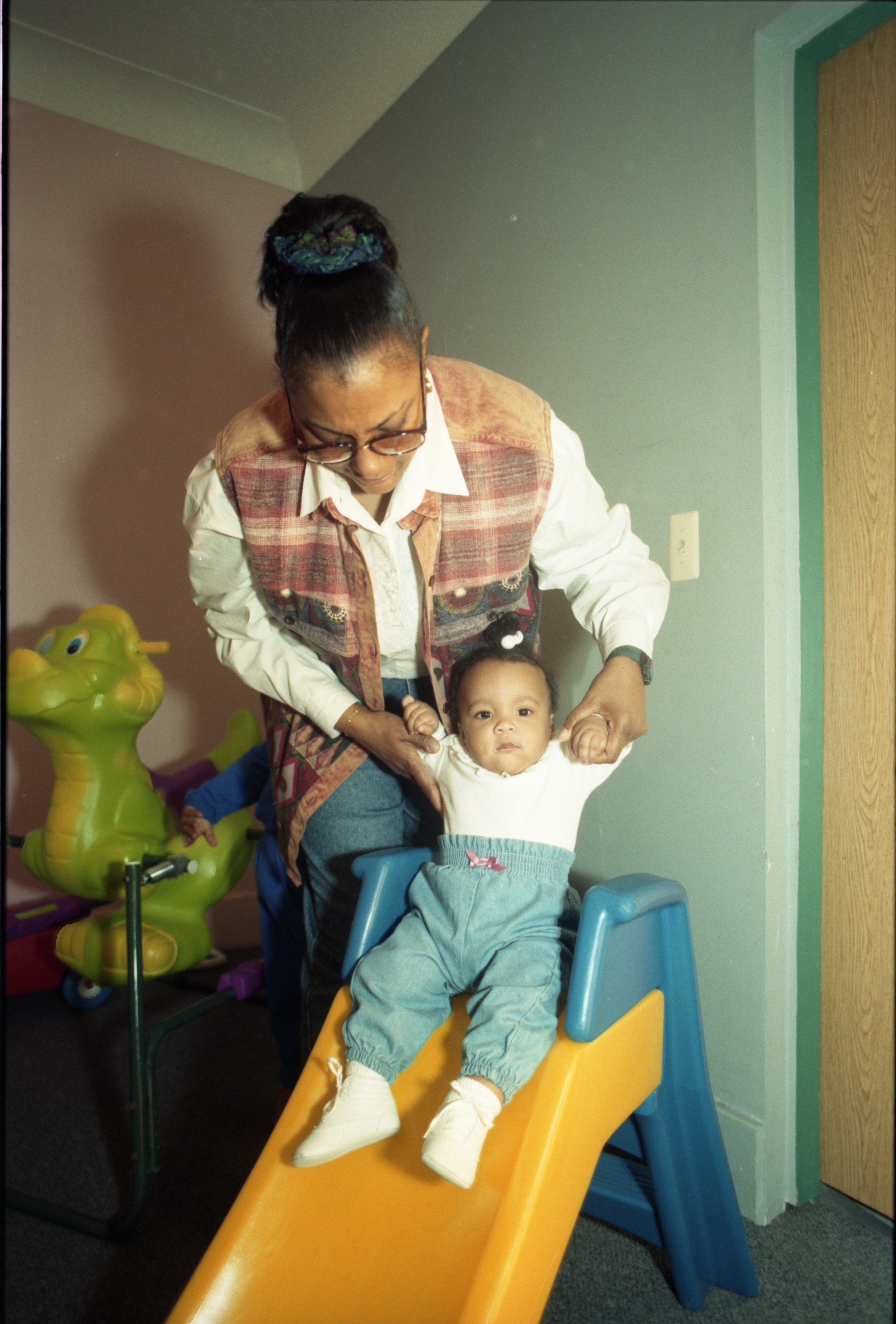 Cheryl Bass-Lee Plays With Annise Summerhill At Noah's Ark Learning Center In Ypsilanti, March 22, 1995 image