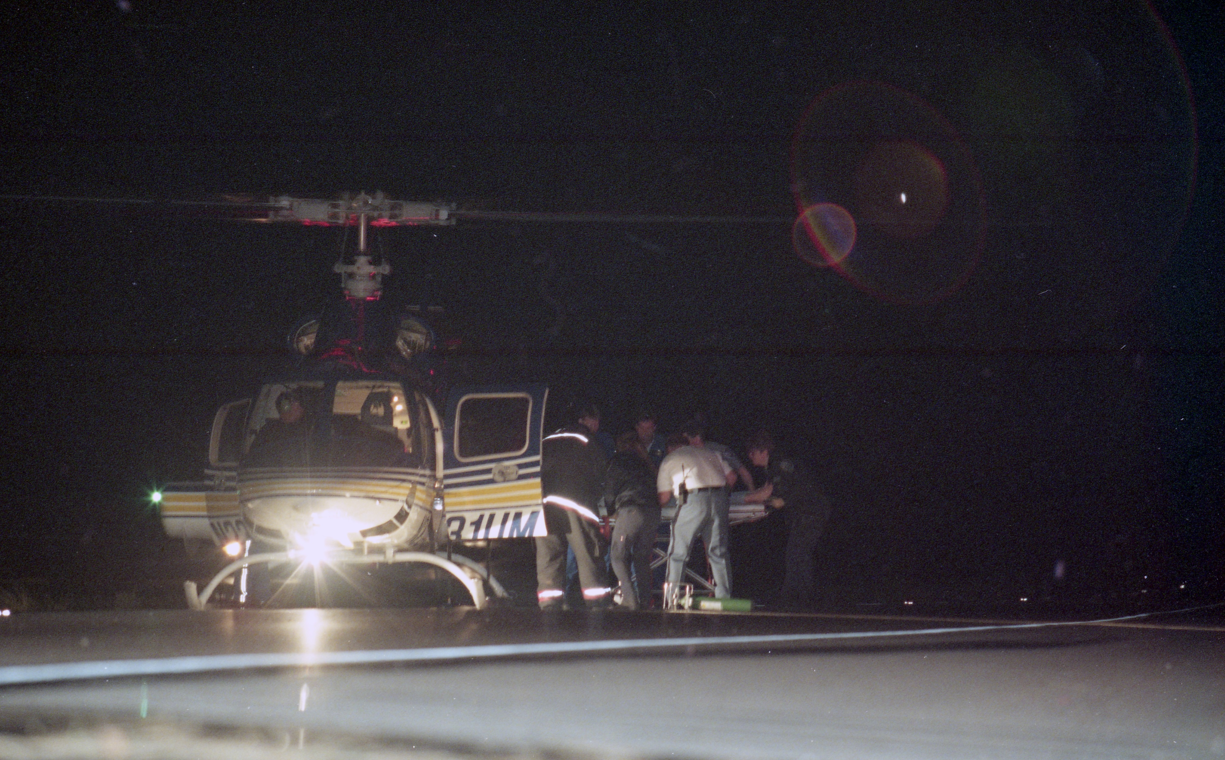 Taylor Calhoun Is Loaded Onto A Survival Flight Helicopter, September 1995 image