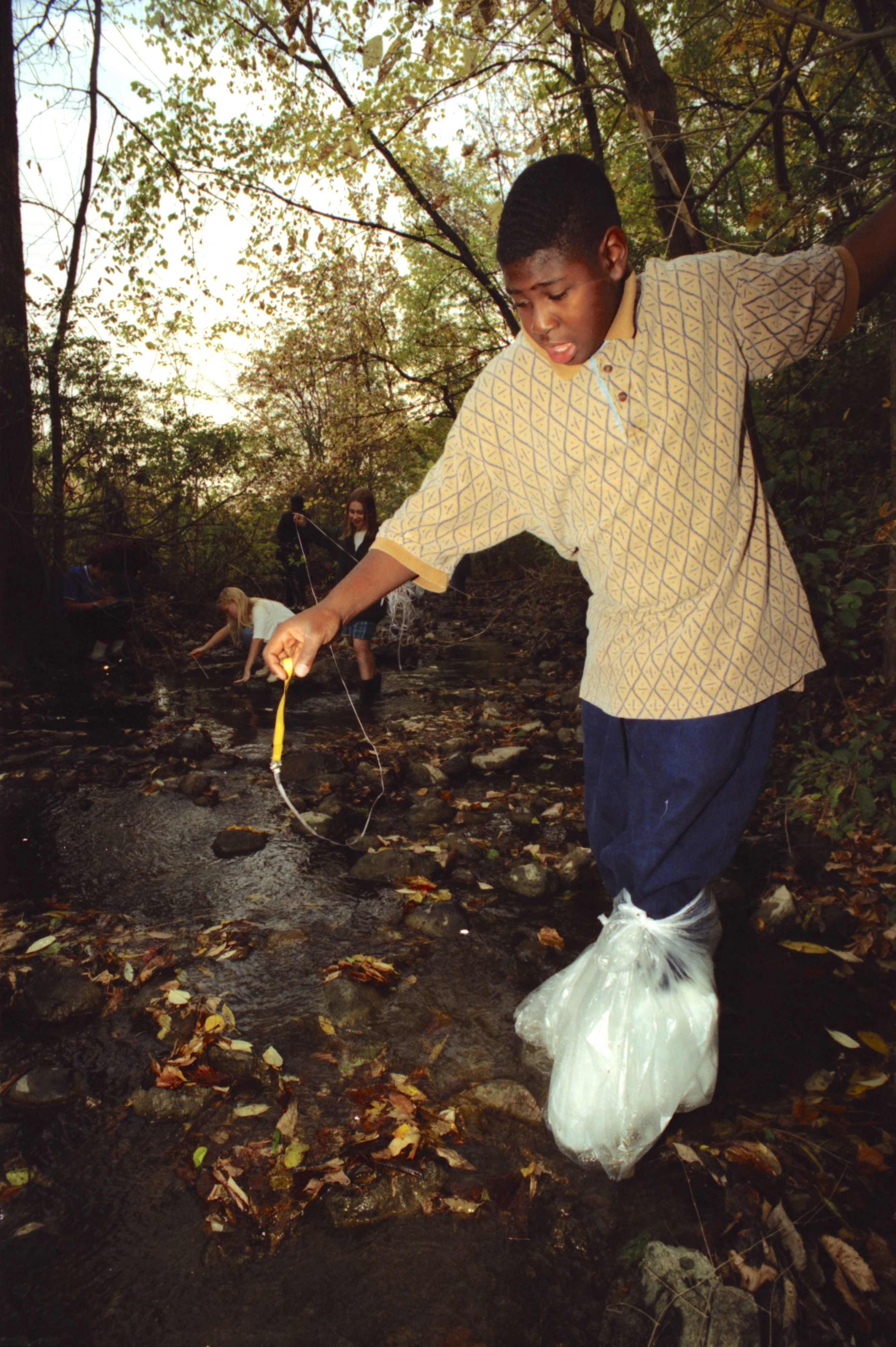 Community High School Student Harlen Turner Wades In Traver Creek, October 1995 image