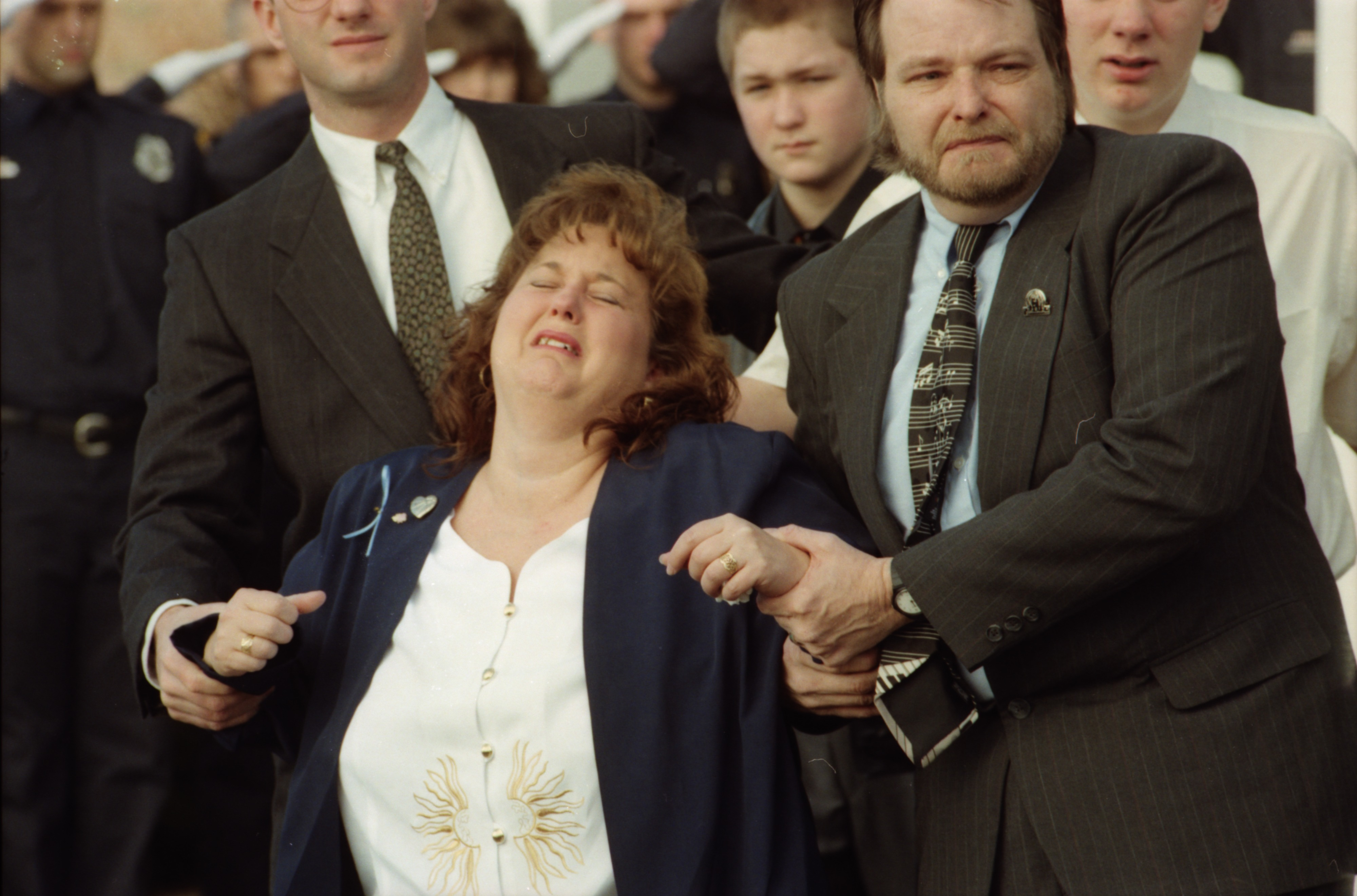 Connie Sampson Mourns her sister Tammy Sperle at her funeral in Saline, February 1996 image