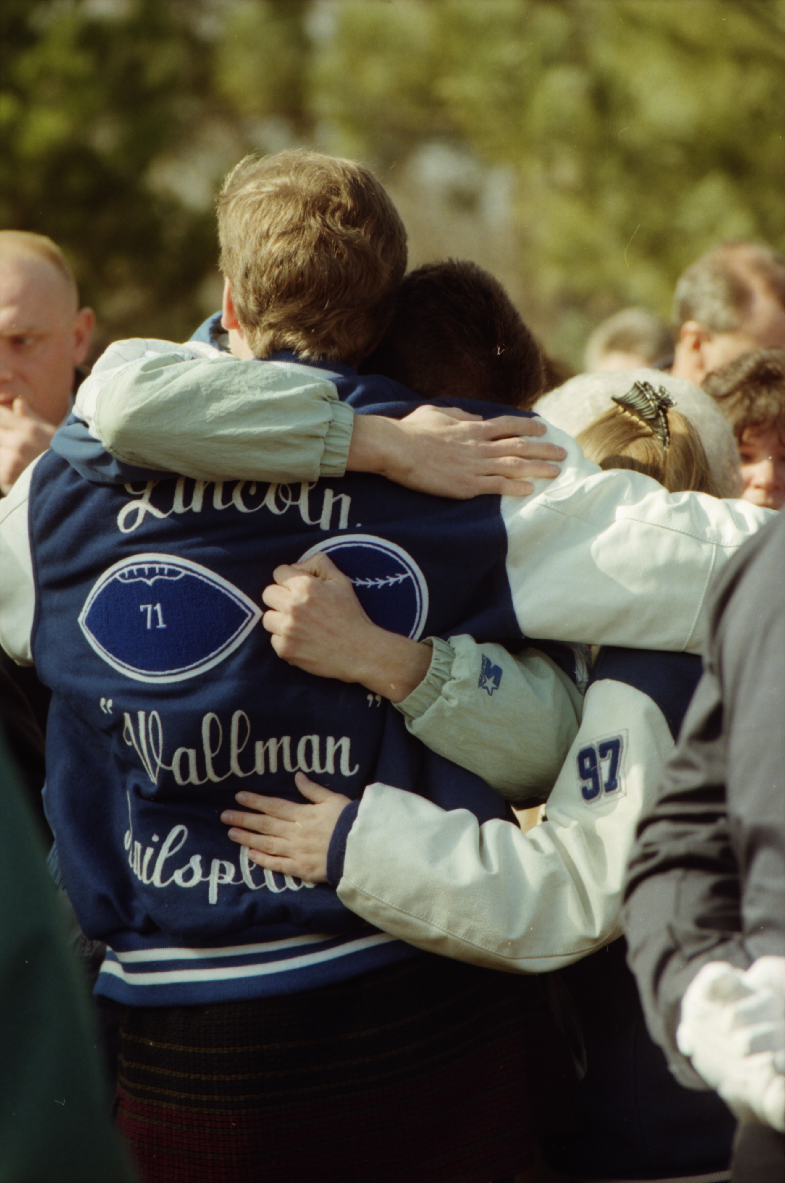 Tammy Sperle's Son Being Comforted by Friends at Oakwood Cemetery in Saline, February 1996 image