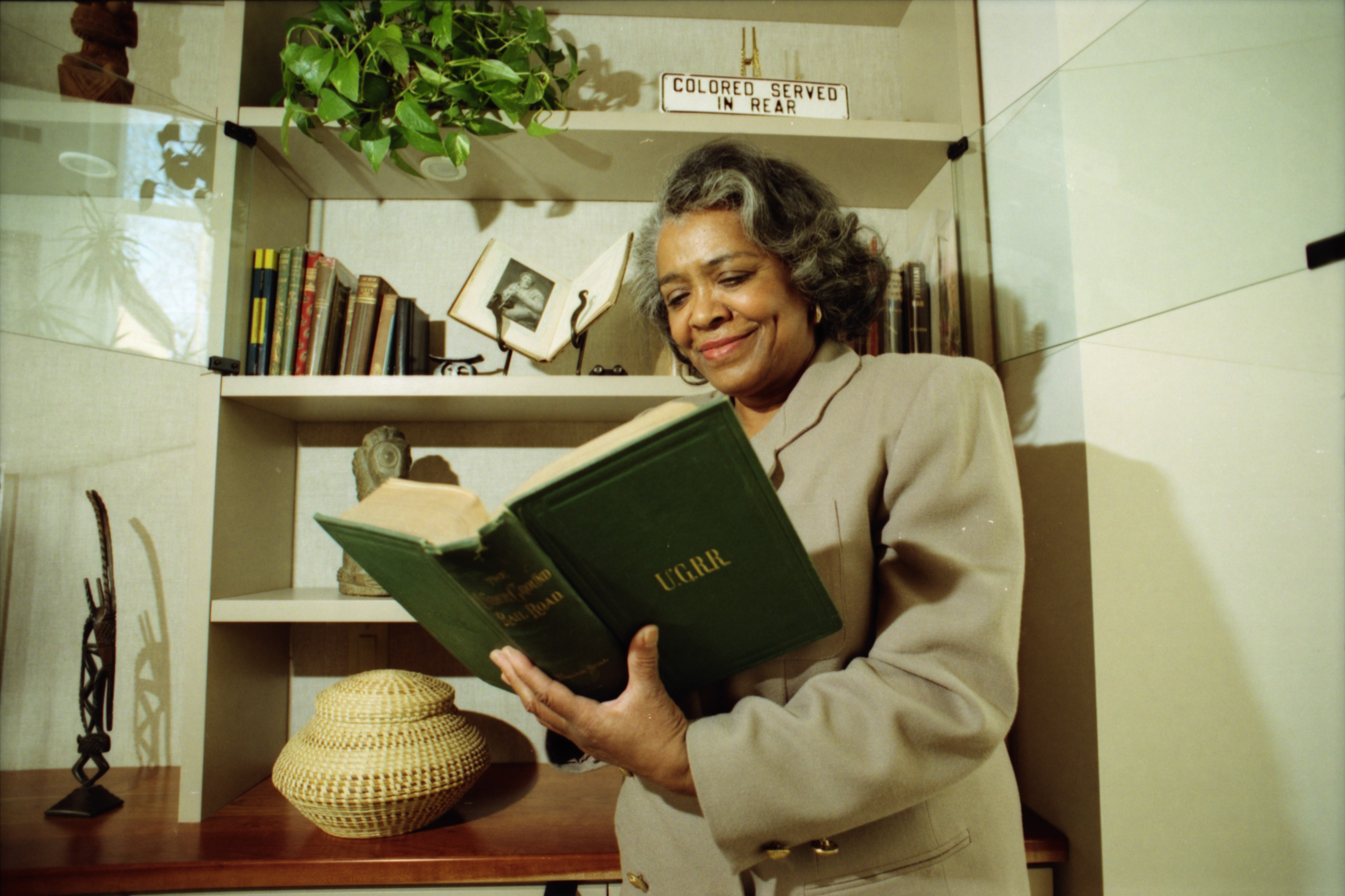 Barbara Meadows Poses With Black History Memorabilia, March 1996 image