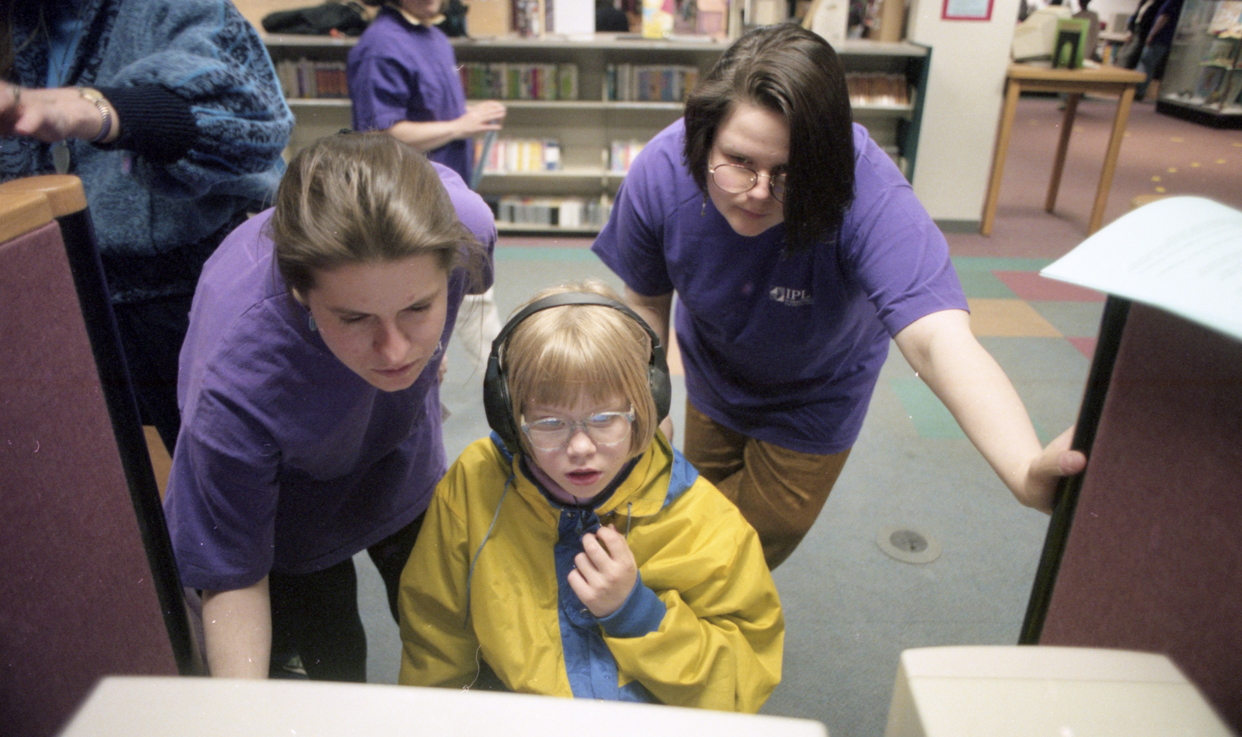 "Marise Bomis, 7, Gets Assistance With A CD-ROM At ""Log On @ The Library"" Day, April 1996 image"