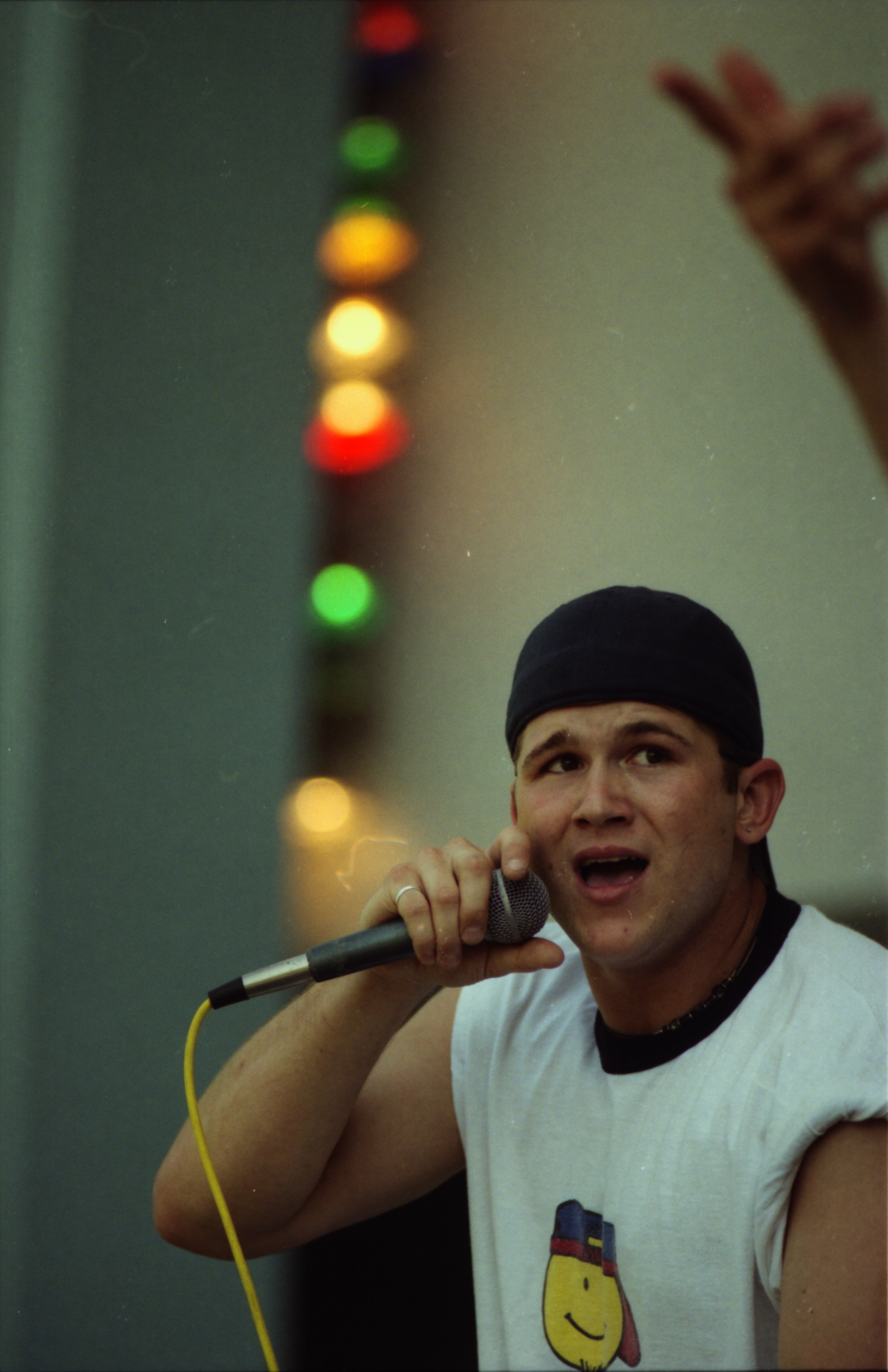 Bob Lillie of The Committee, a local hip-hop band, performs at Comstock, West Park, June 13, 1996 image