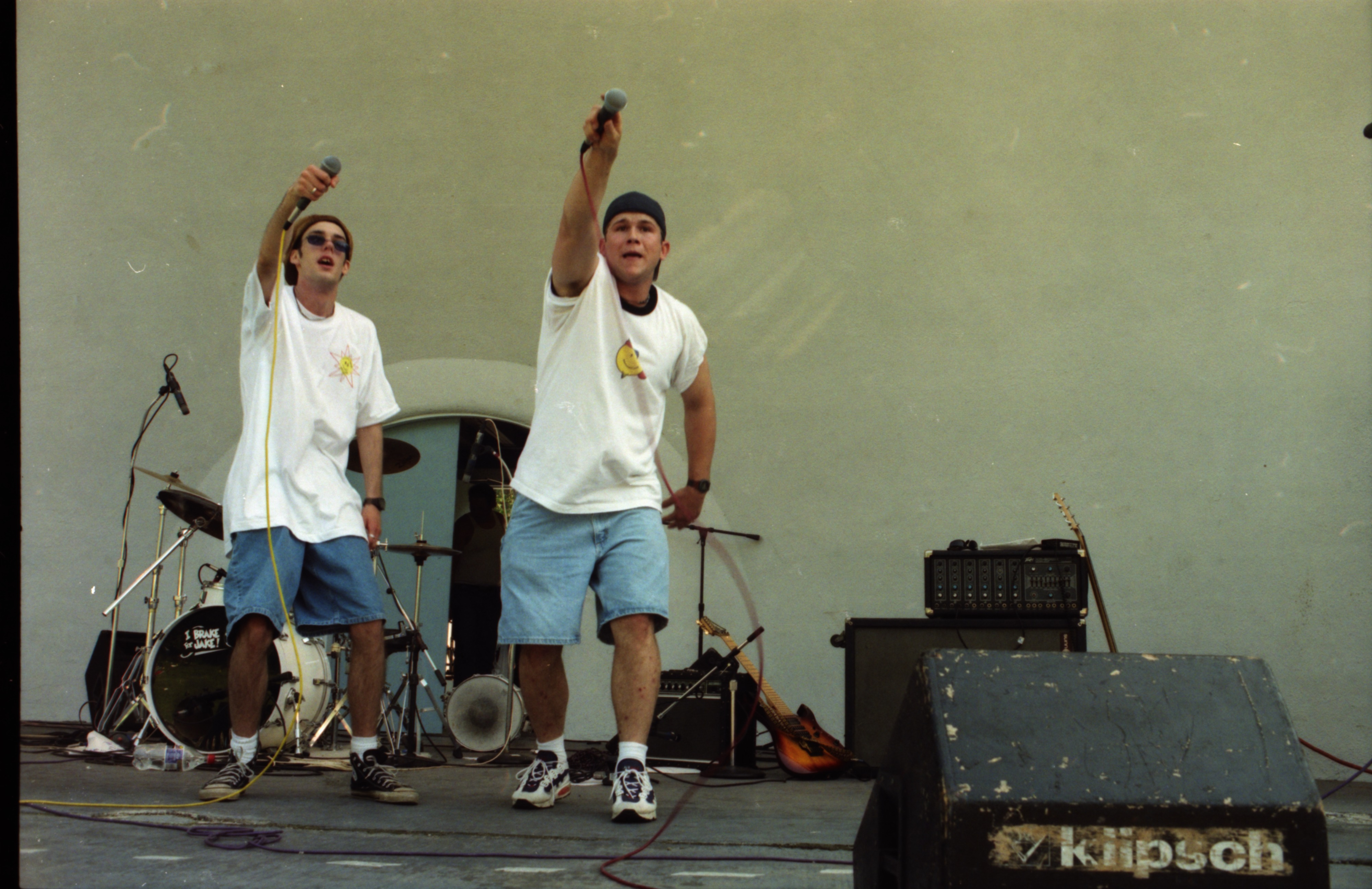Jon Gore and Bob Lillie of The Committee, a local hip-hop band, perform at Comstock, West Park, June 13, 1996 image