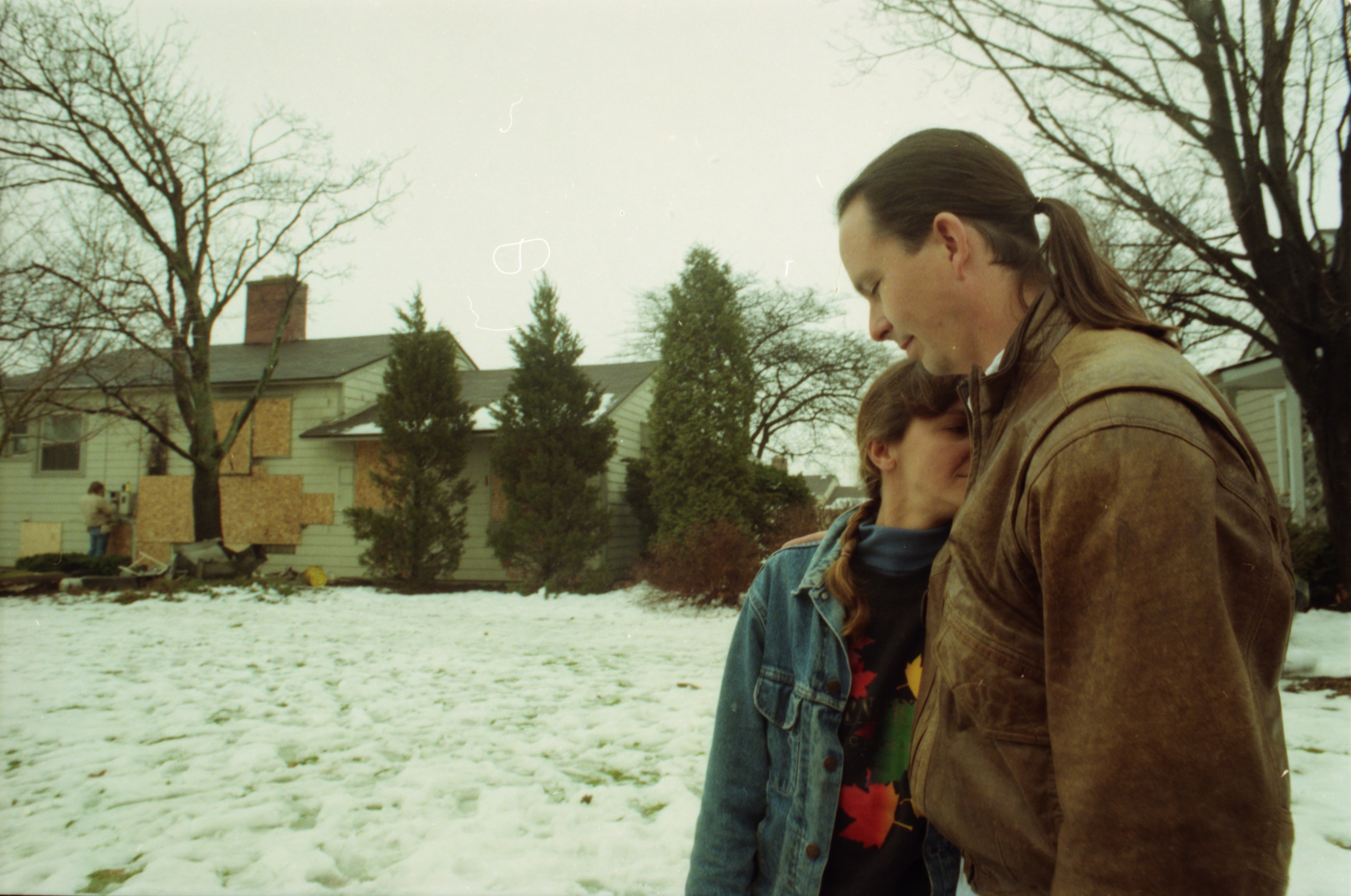 Portrait of Jan and Devon Smith Outside their Fire Damaged Home, December 1996 image