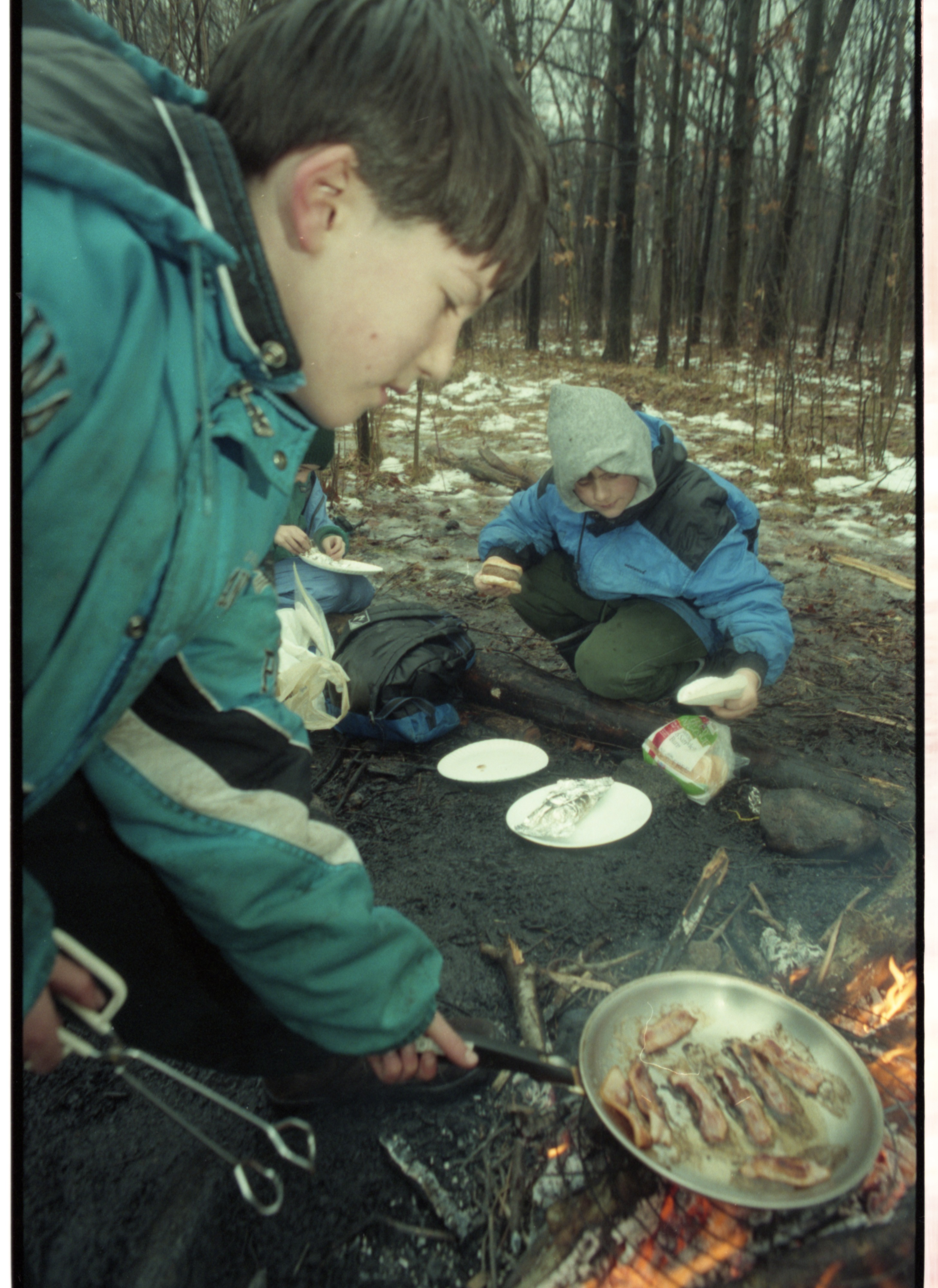 Eberwhite School Students Cook A Meal In Winter Survival Skills Outing, January 1997 image