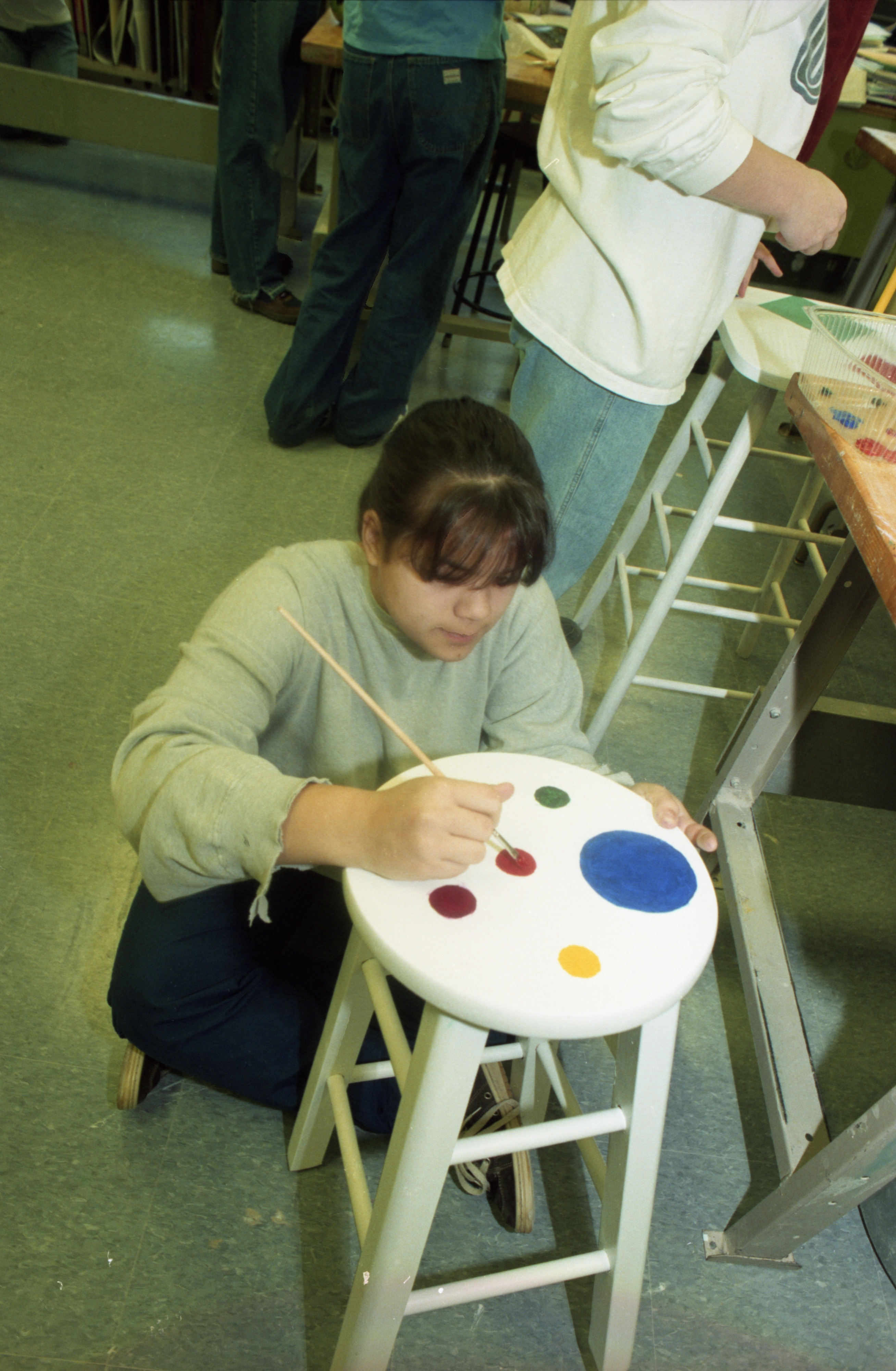 Student Paints A Stool For Greenhills' Fundraiser, February 19, 1997 image
