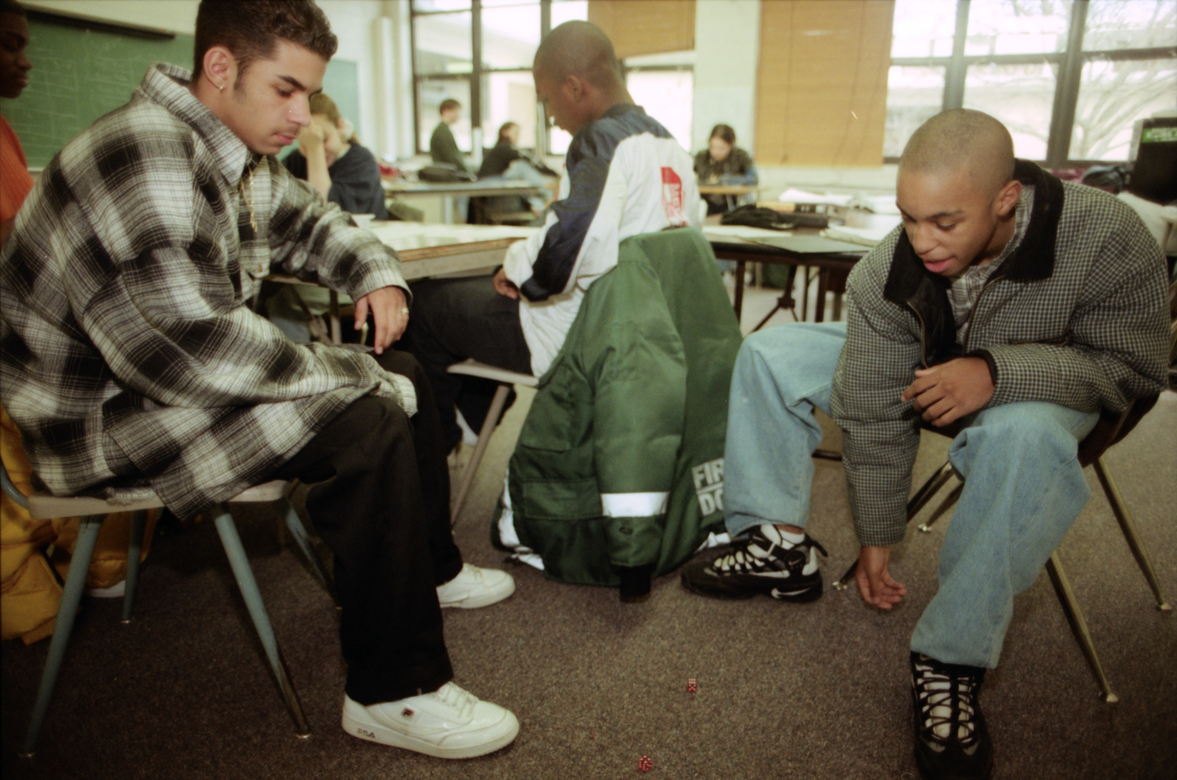 Mike Donahue and Justin Harper play dice at New School, March 1997 image