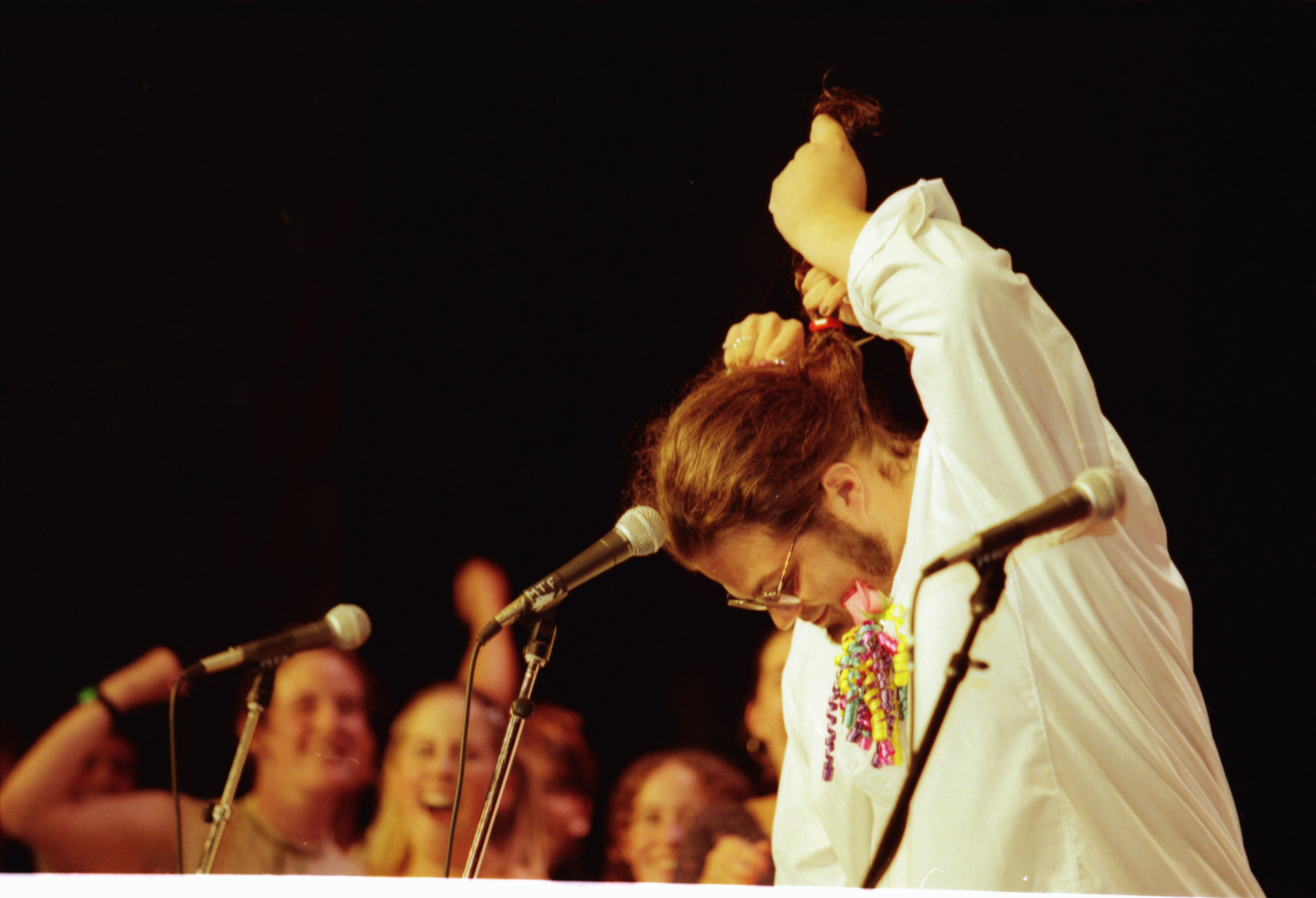 Community High Graduate Snips Hair at Commencement, June 1997 image