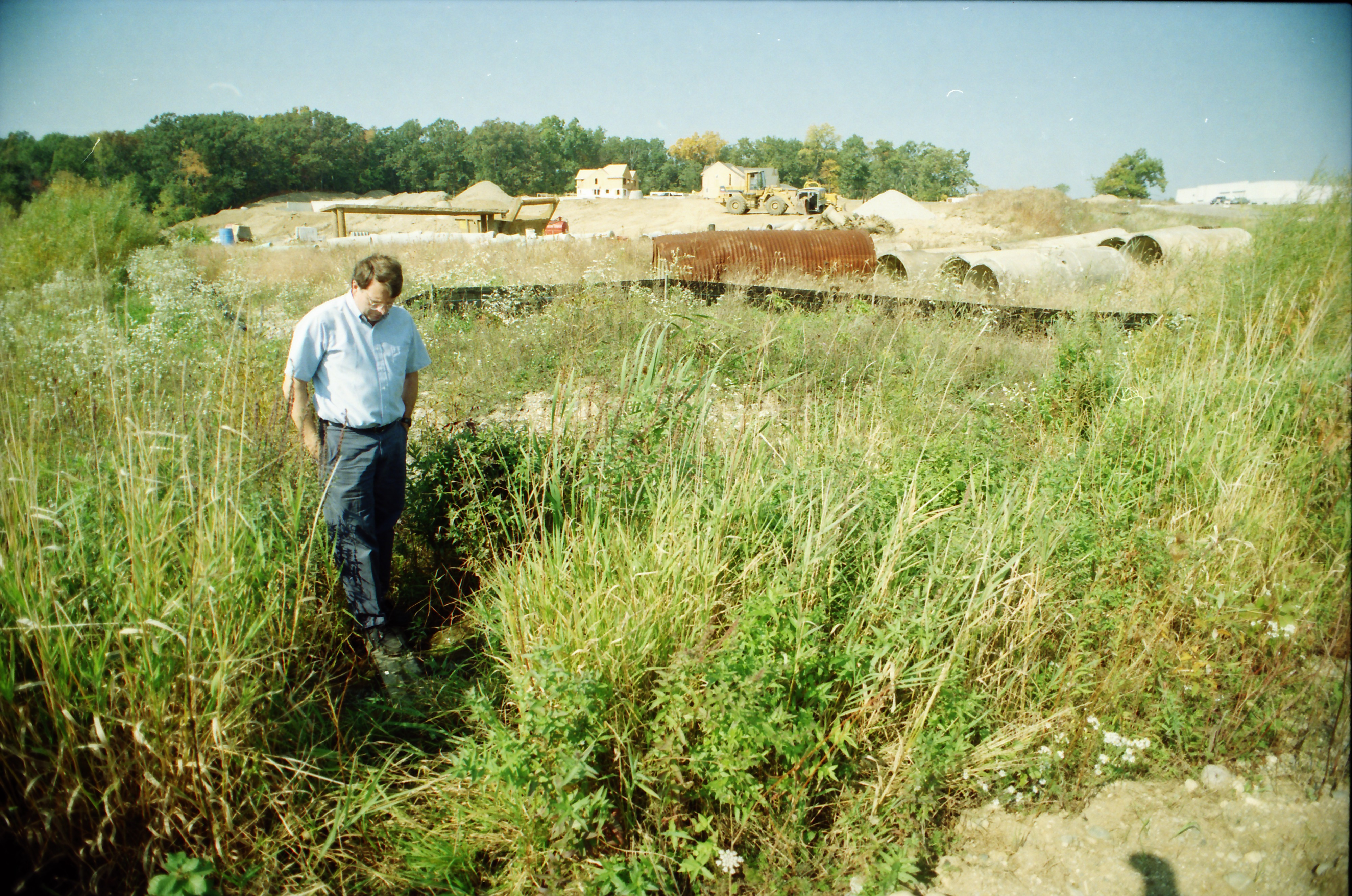 Roger Rayle Inspects a Tributary That Flows from the Pall-Gelman Sciences Property, September 1997 image
