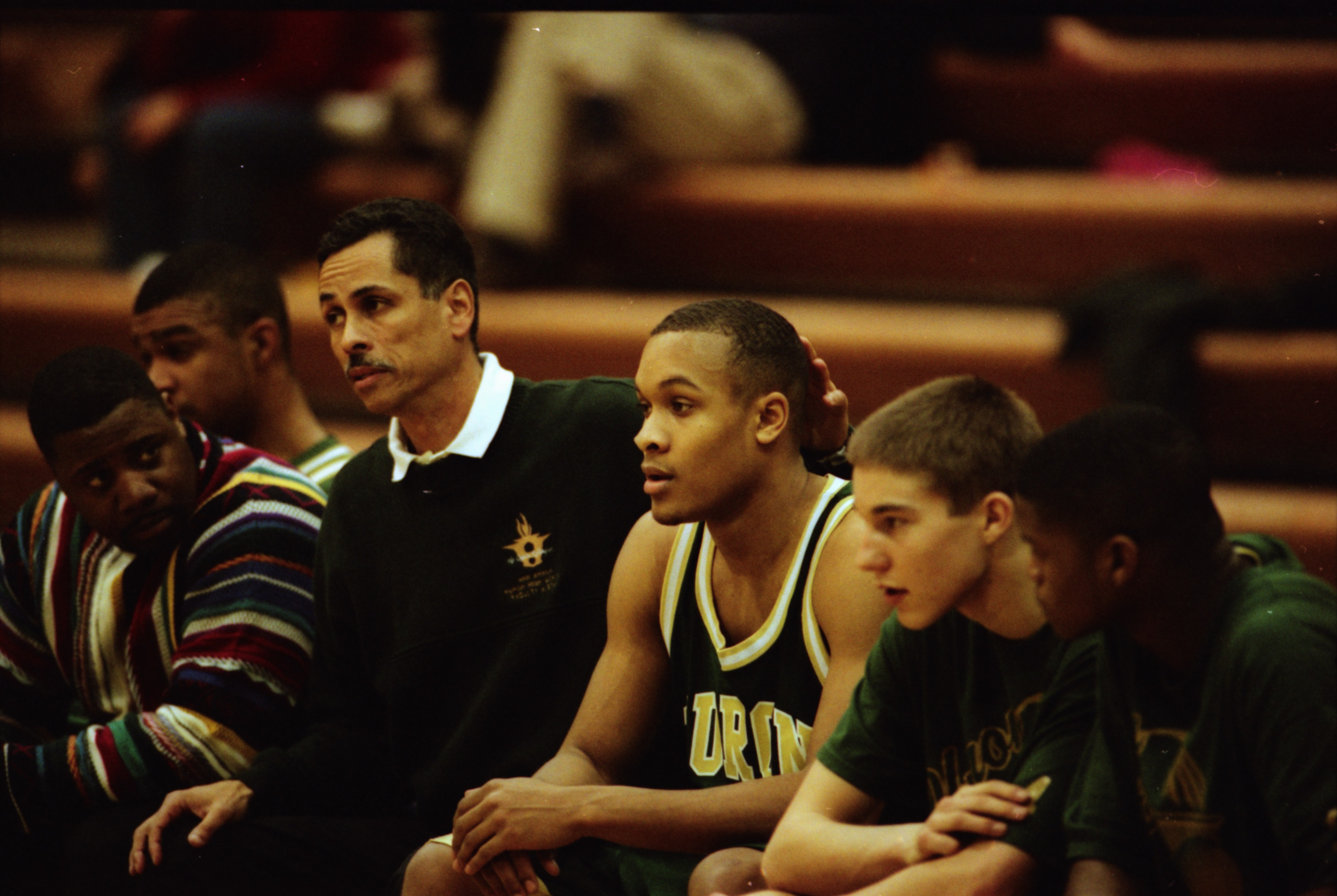 Huron Basketball Coach Harold Simons Sits on Bench with Players, March 1998 image