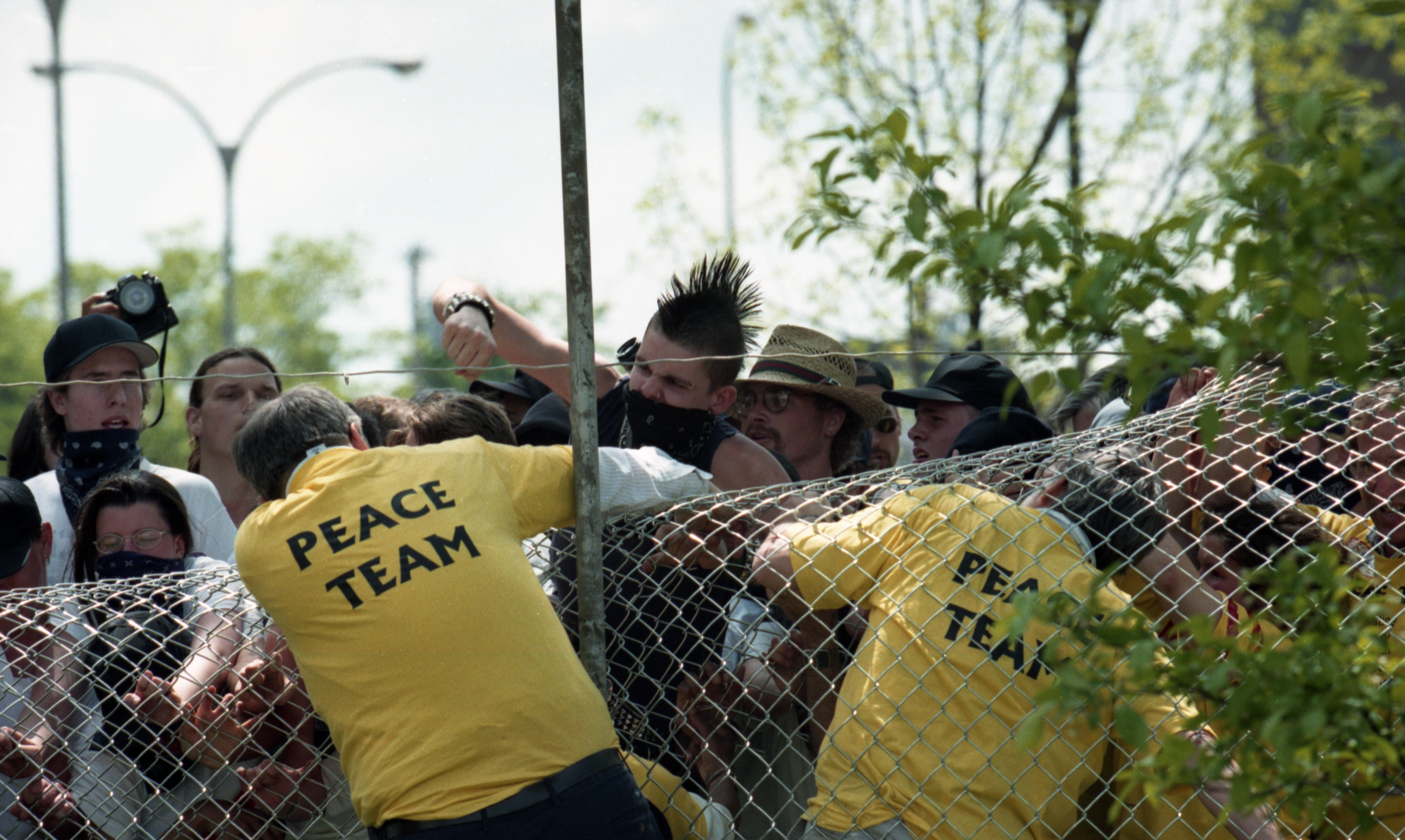 Peacekeepers' Team Members & KKK Rally Spectators Clash At Fence Around Larcom Building, May 1998 image