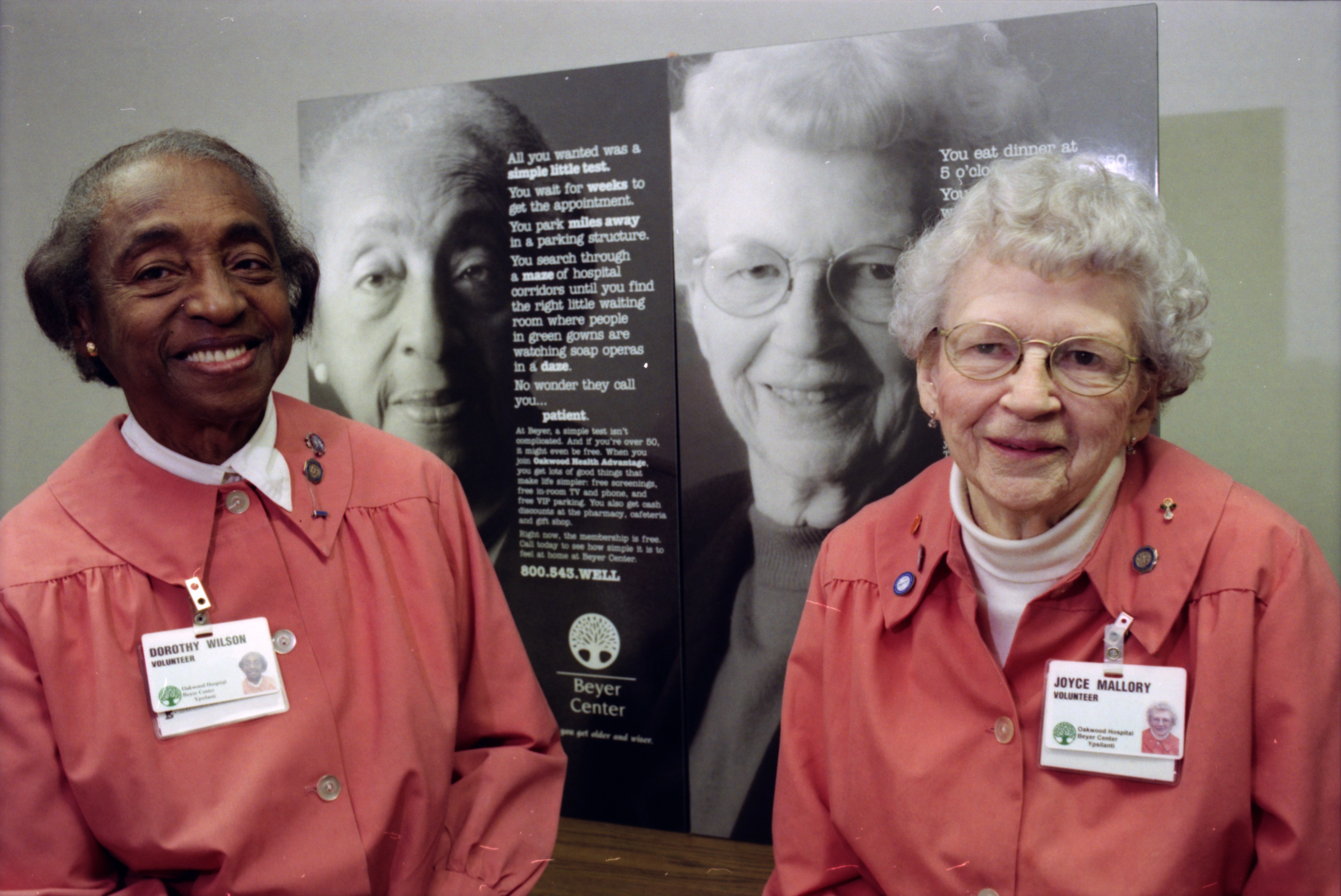 Dorothy Wilson and Joyce Mallory Pose in Front of Ads for the Beyer Center, February 1999 image