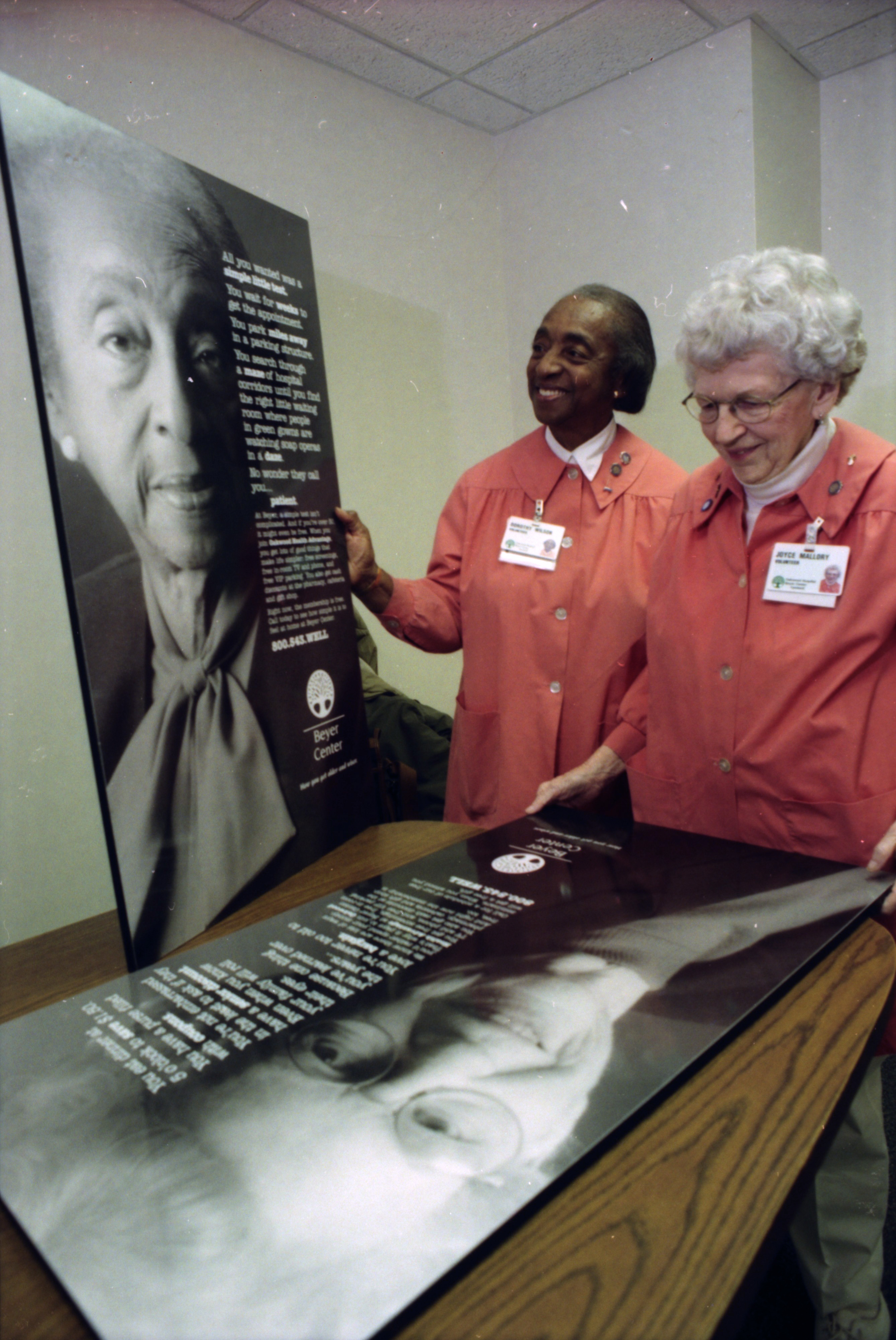 Volunteers Dorothy Wilson and Joyce Mallory Admire Ads for the Beyer Center, February 1999 image