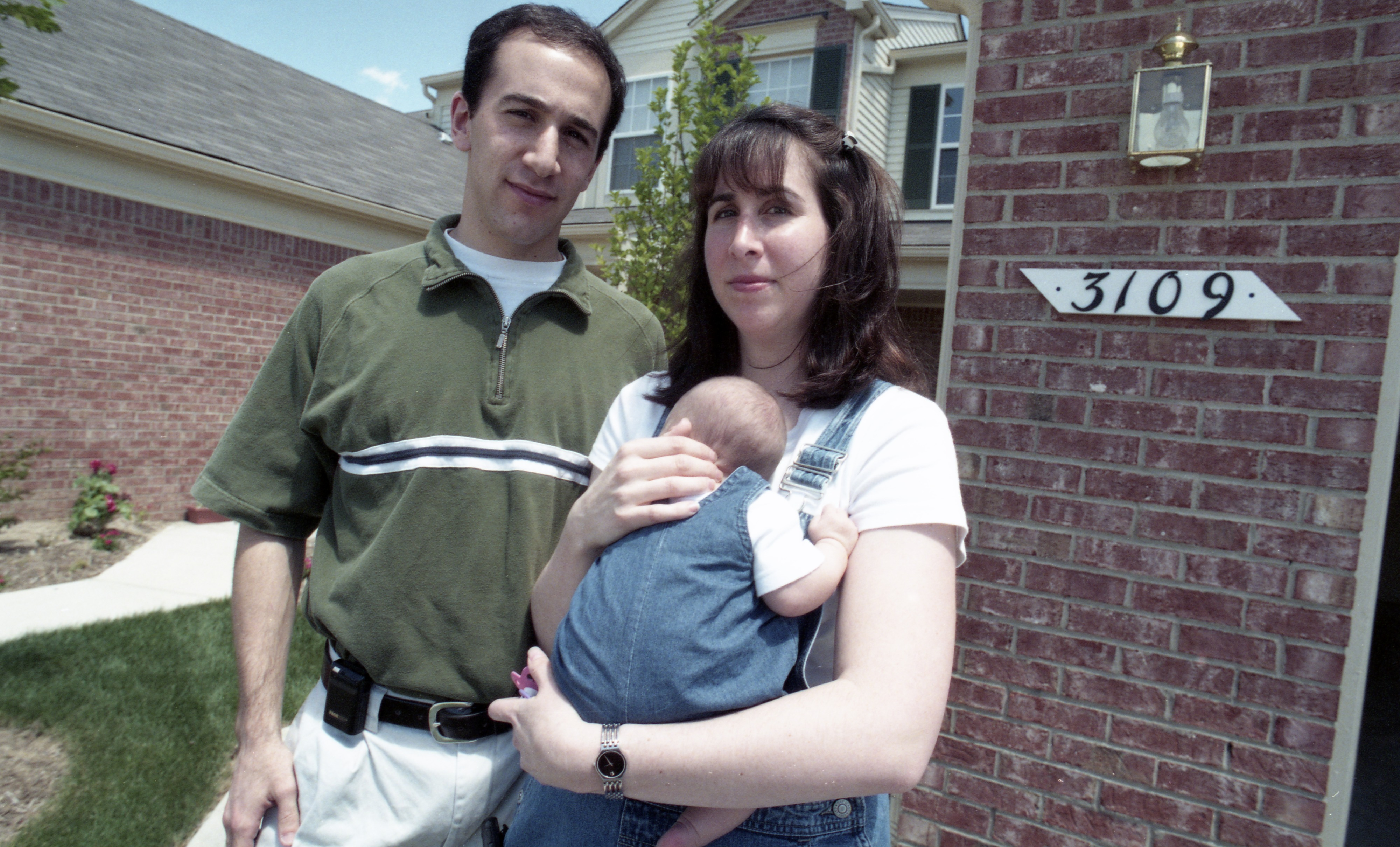 The Bernard Family In Front Of Their Turnberry Subdivision Condominium, July 1999 image
