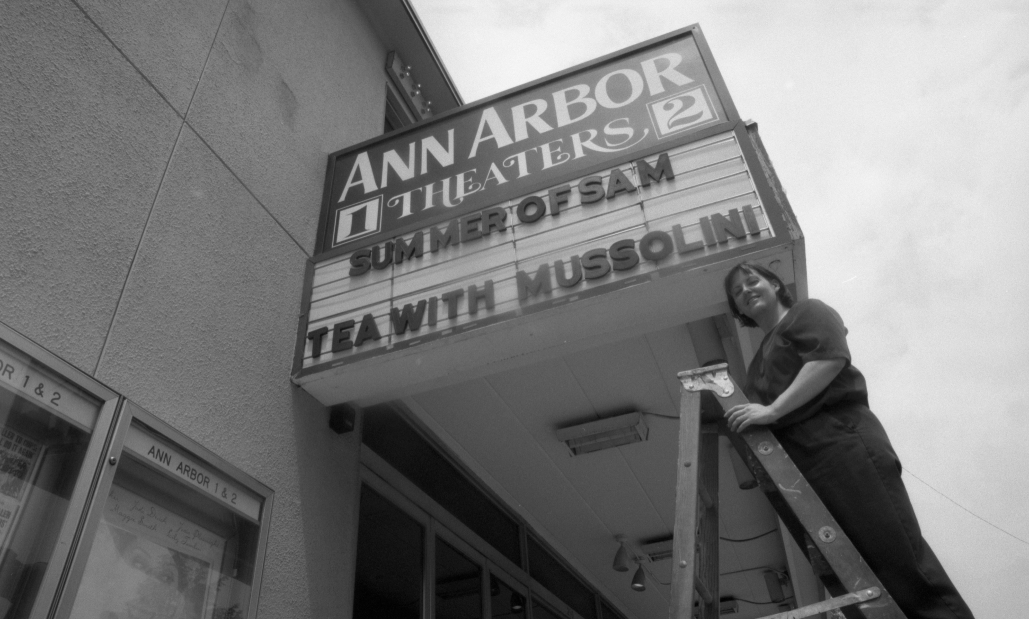 Ann Arbor Theaters 1 & 2, 210 S Fifth Ave, Manager Sue Heckenbrook In Front of Marquee, July 1999 image