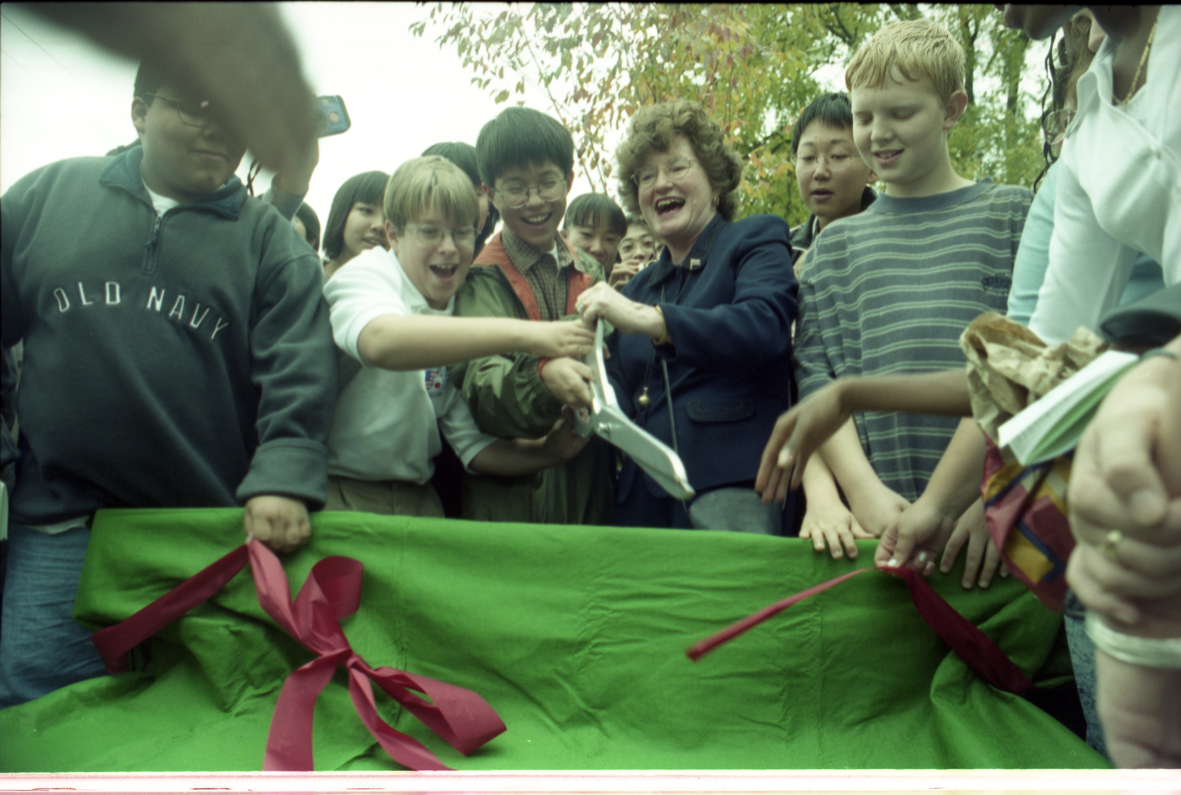 Mayor Ingrid Sheldon With Assistance From Students Cuts Ribbon For Bench Commemorating 30th Anniversary Hikone-Ann Arbor Sister Cities, October 11, 1999 image