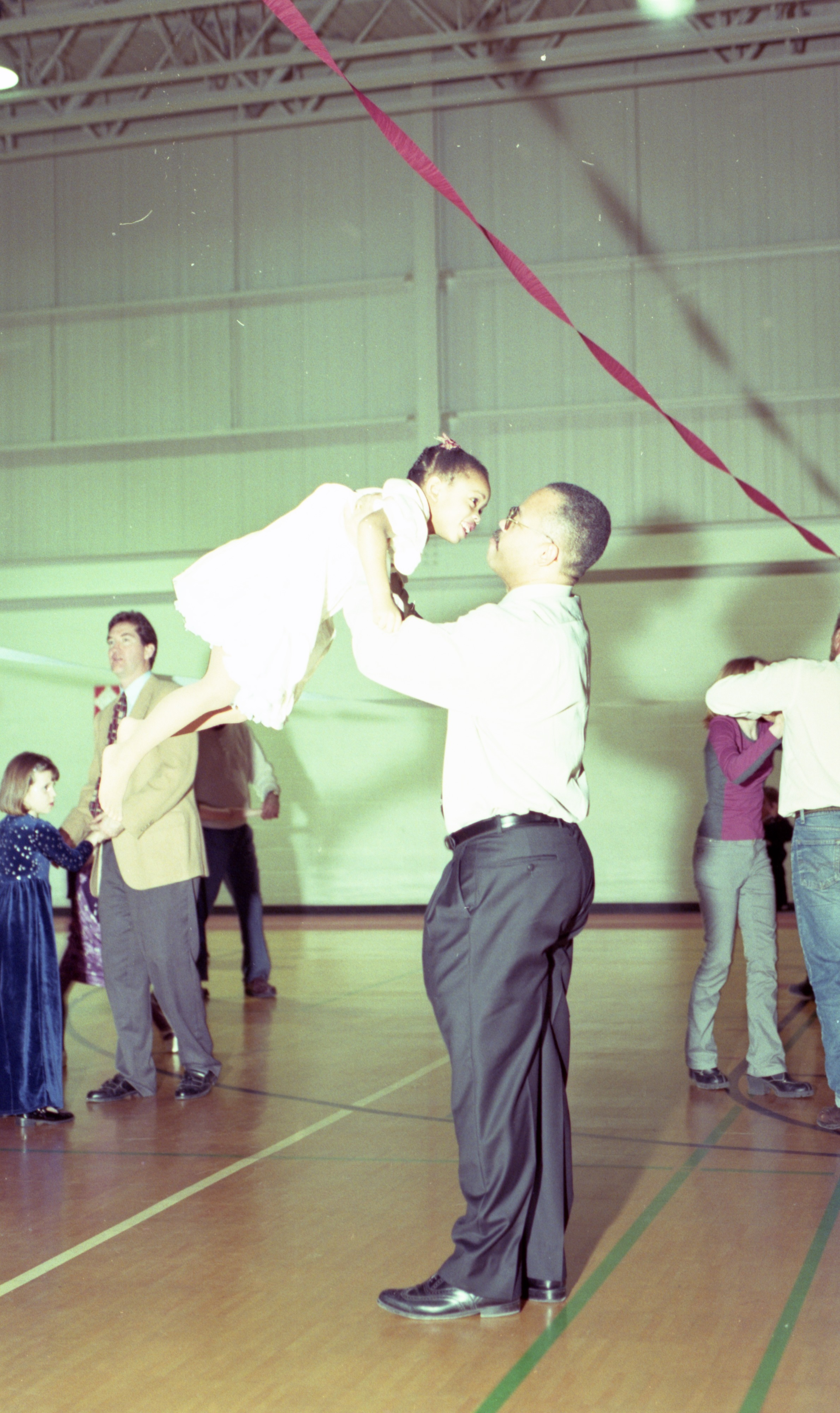 Raymond Fears Swings His Daughter Iman At The Daddy/Daughter Valentines Dance, February 2000 image