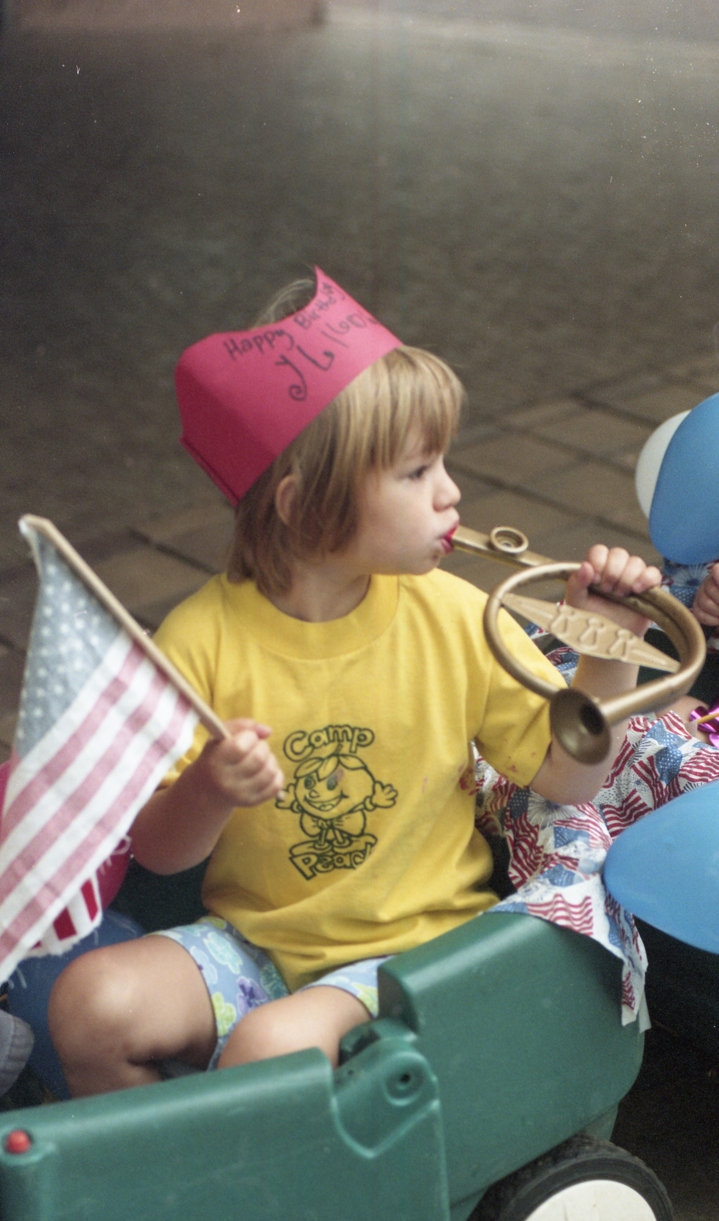 Lily Robins Plays A Horn In The Camp Peachy Pre-Independence Day Parade, July 2000 image