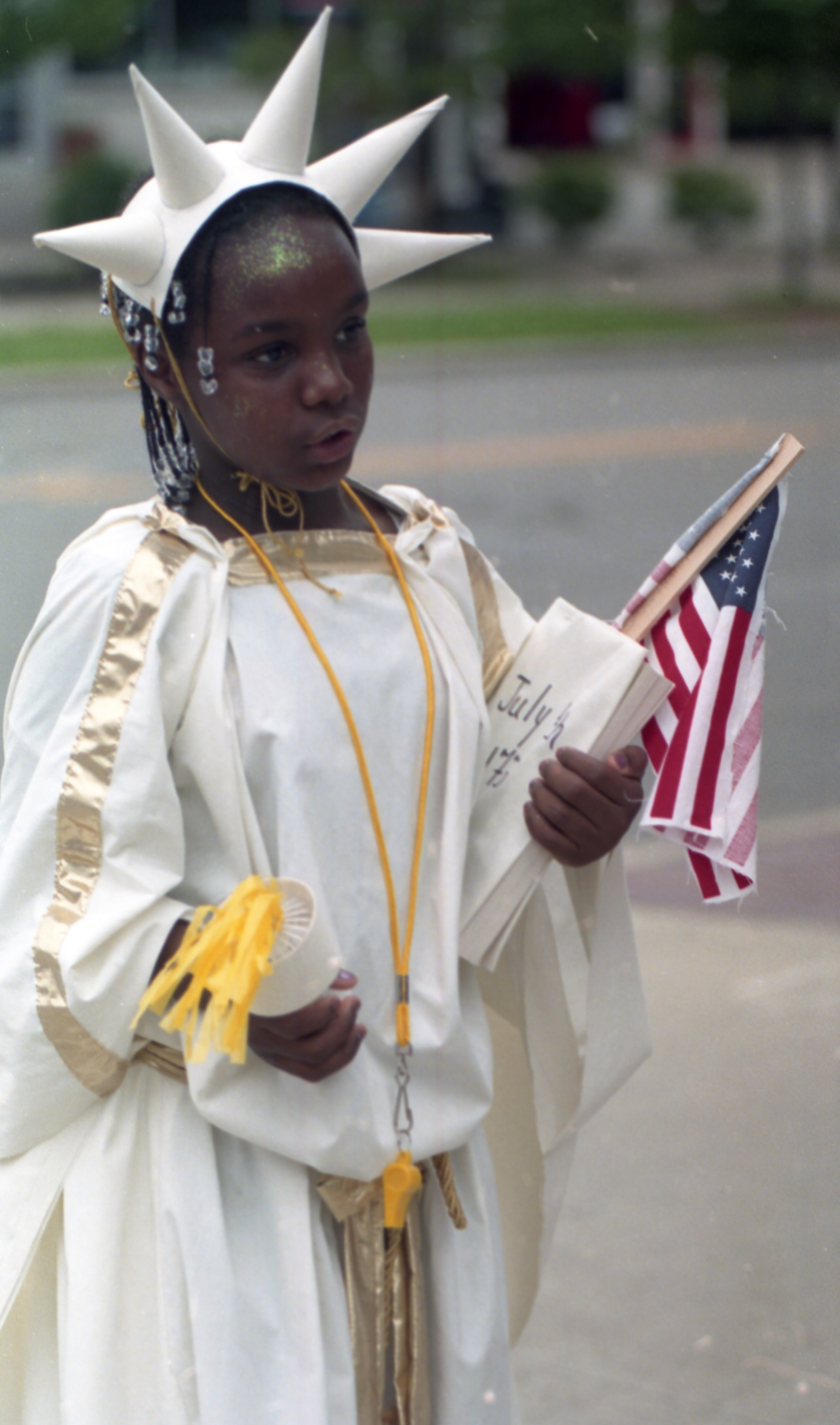 Nakaiya Harrison Marches As The Statue Of Liberty In The Camp Peachy Pre-Independence Day Parade, July 2000 image